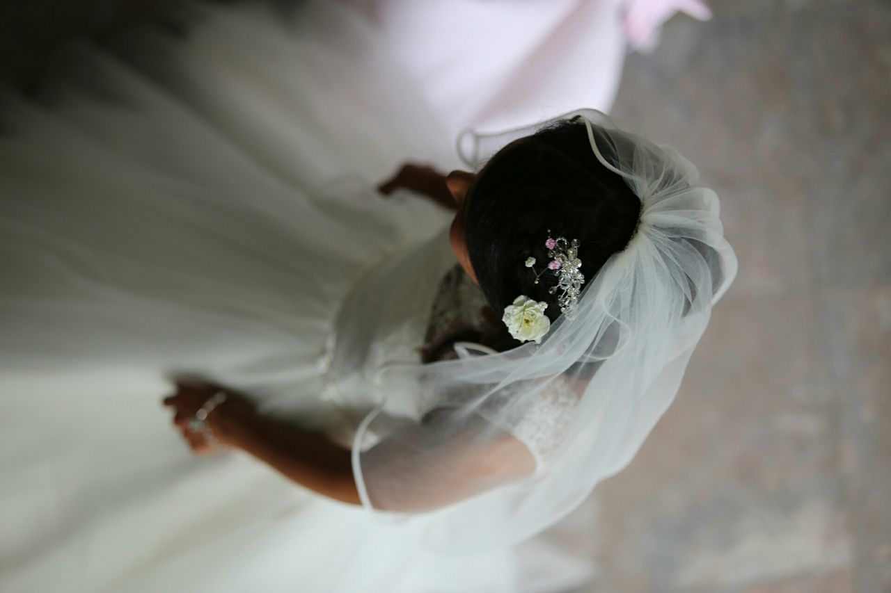 Directly Above Shot Of Bride Standing On Floor
