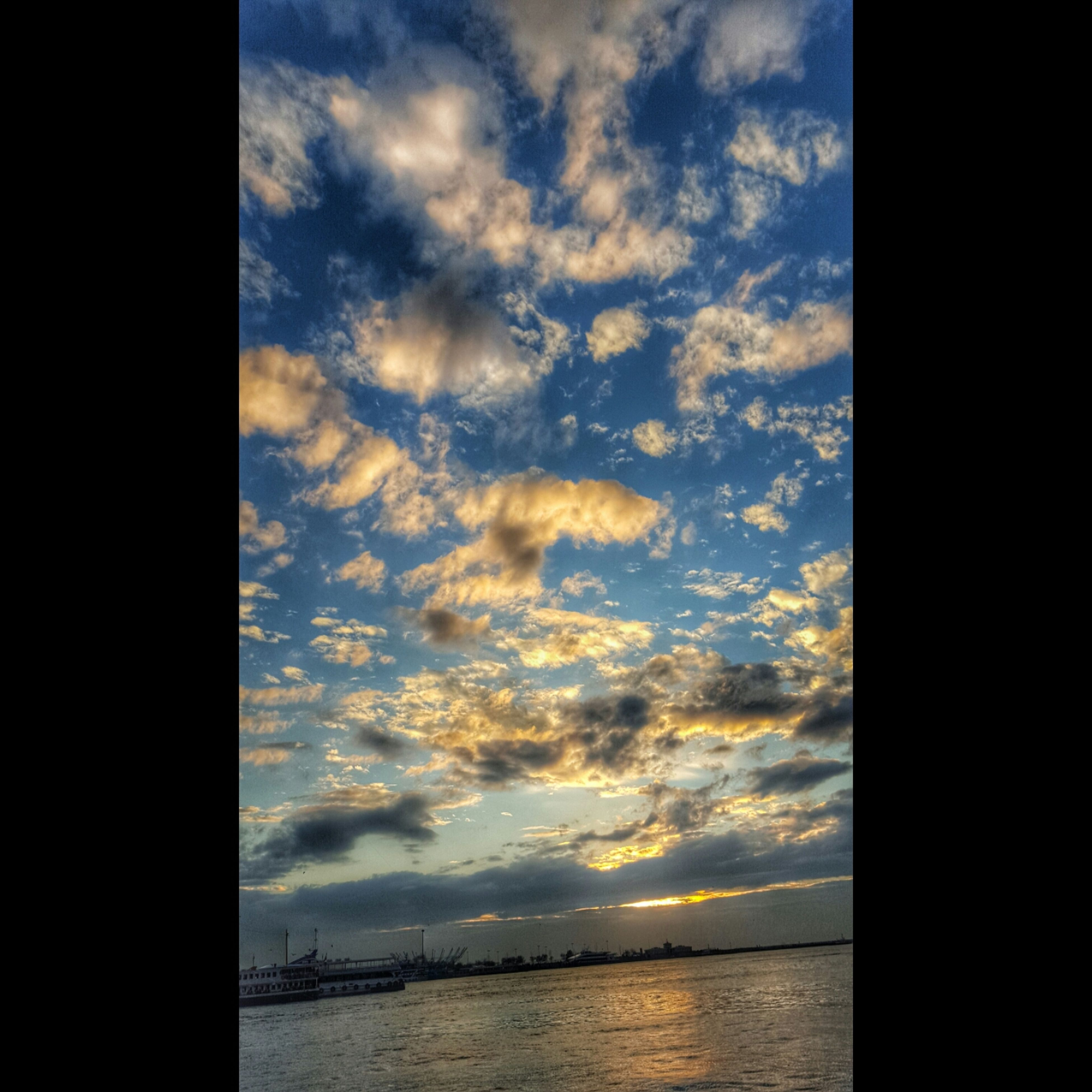 sky, water, sea, sunset, scenics, tranquility, tranquil scene, waterfront, cloud - sky, beauty in nature, silhouette, horizon over water, nature, cloud, idyllic, cloudy, reflection, calm, outdoors, no people
