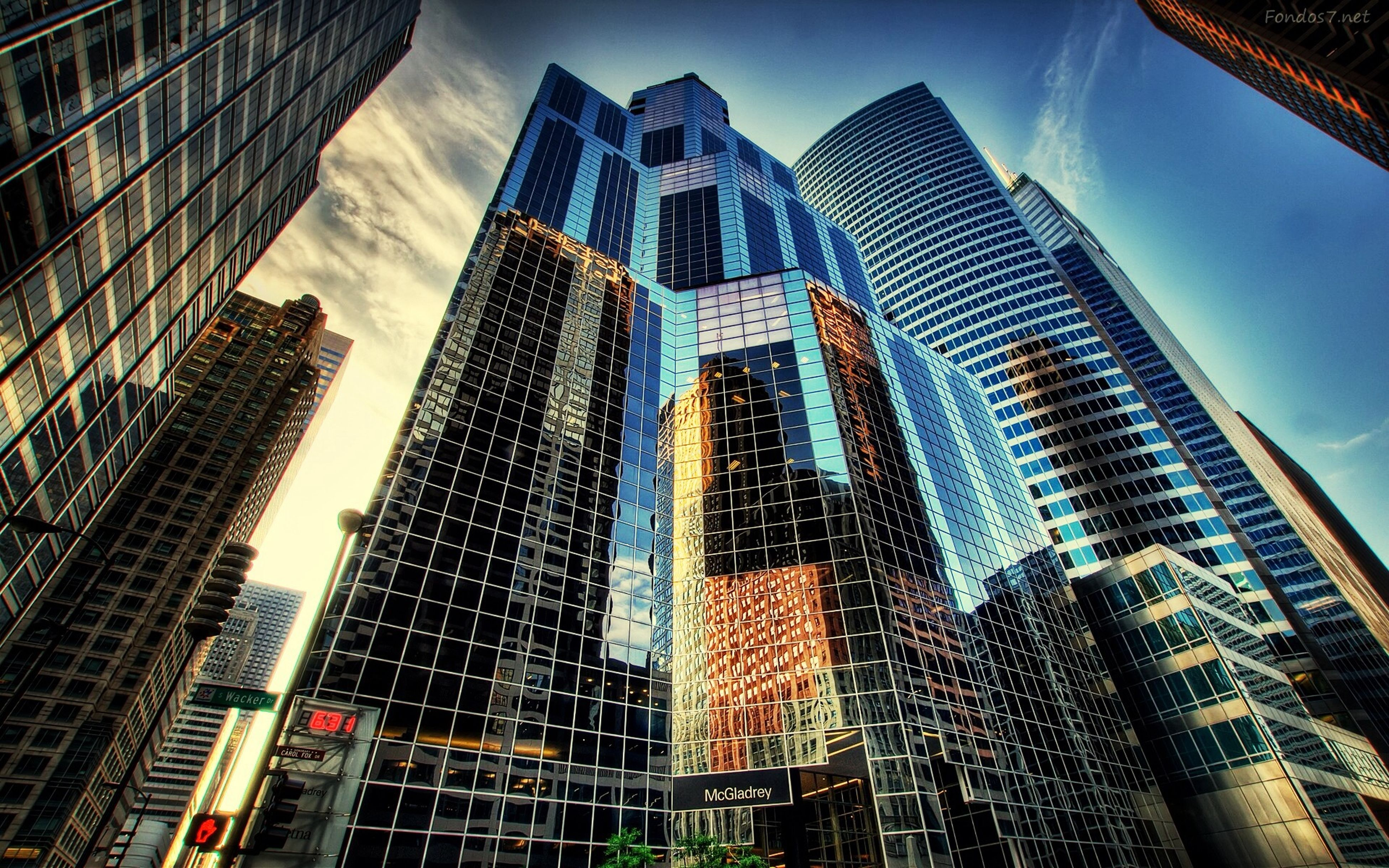 building exterior, architecture, city, built structure, skyscraper, modern, office building, tall - high, low angle view, tower, sky, reflection, building, glass - material, financial district, city life, tall, cityscape, day, residential building
