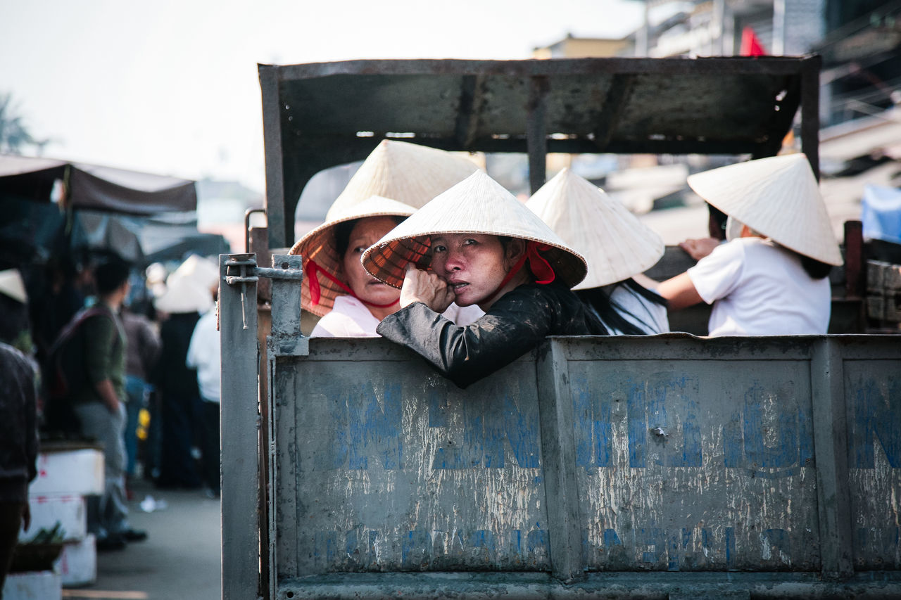 Hoi An, Vietnam central Vietnam communication Commuting extras group of people Hoian Hoian, Vietnam leaf hat Looking At Camera movie extras Movie Set nonla Old Town Old Truck on the road people portrait South East Asia street photography streetphoto streetphotography Travel Photography truck Vietnam Workers