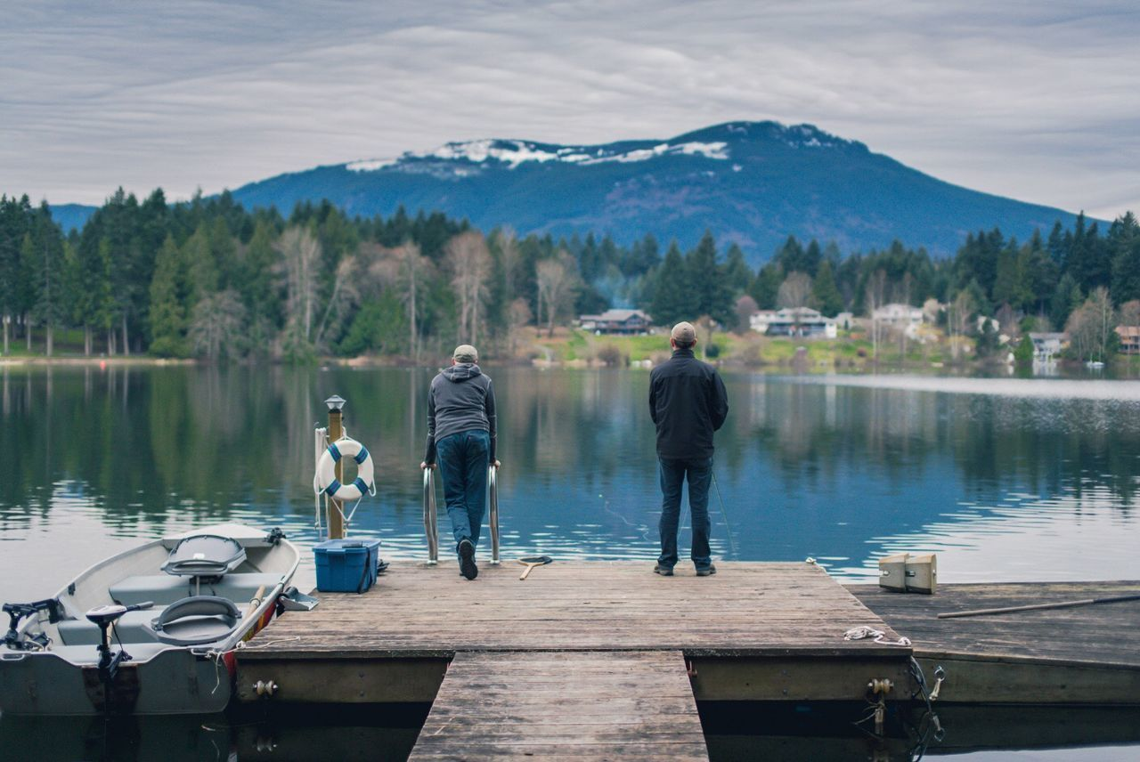 Father & Son Fly Fishing from a Dock on Fuller Lake in Chemainus British Columbia Canada