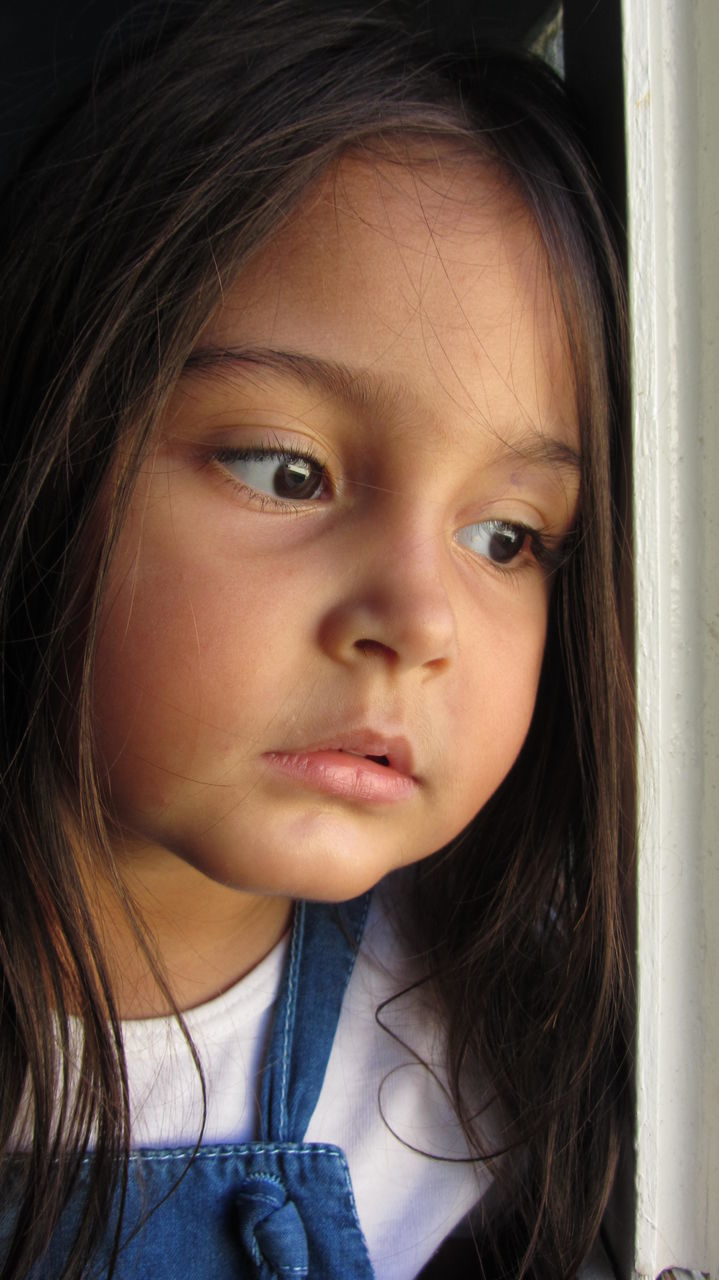 Close-up Portrait Of Young Girl