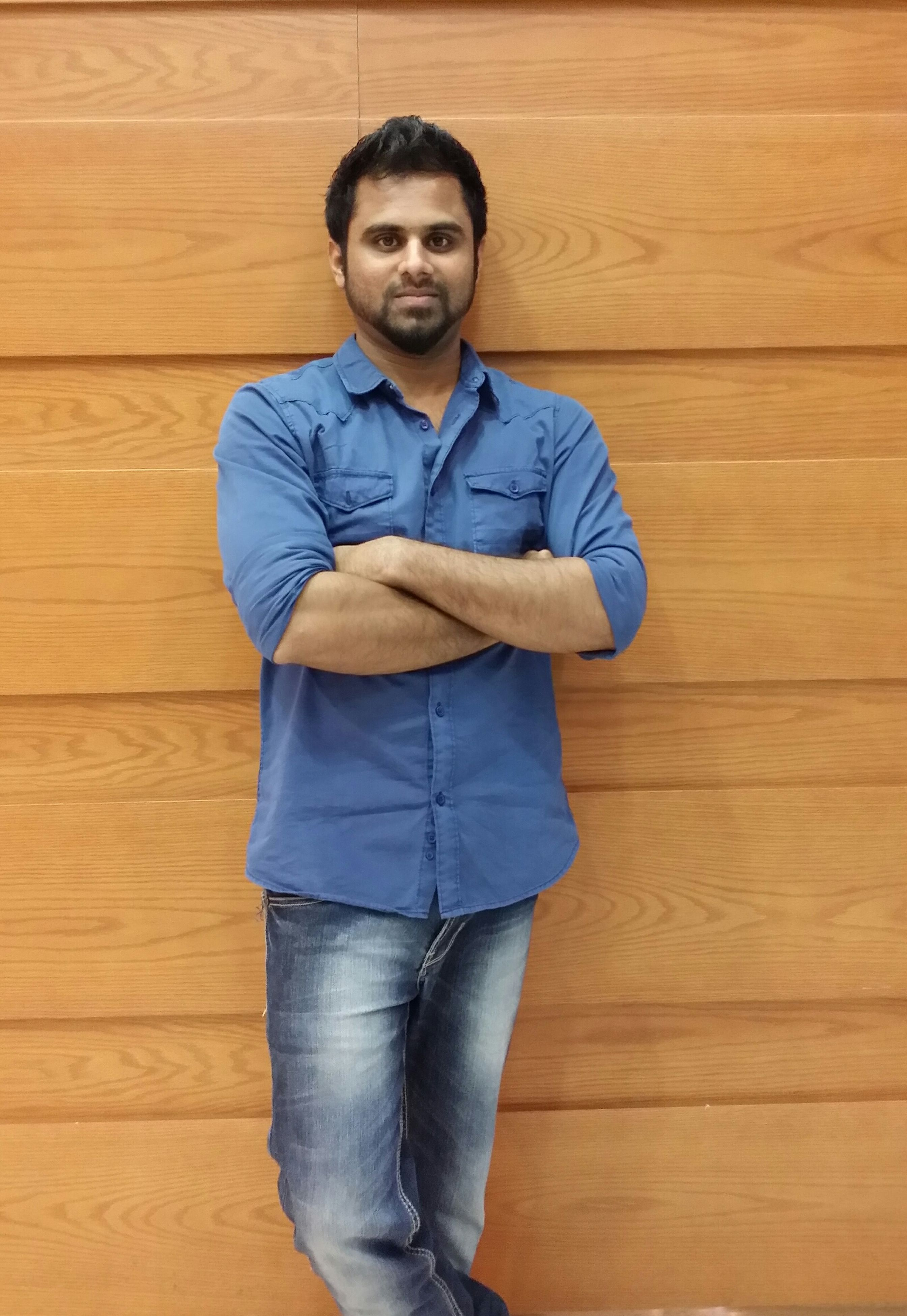 looking at camera, wood - material, portrait, person, casual clothing, lifestyles, indoors, front view, wooden, leisure activity, smiling, standing, full length, childhood, hardwood floor, happiness, boys, high angle view