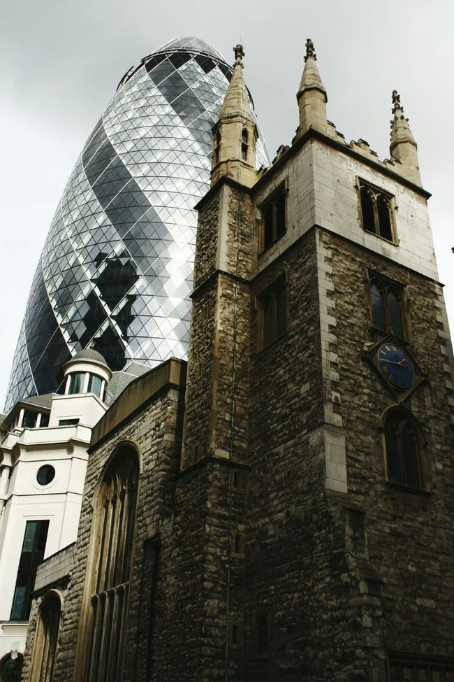 The Architect - 2016 EyeEm Awards London Architecture London's Buildings Londoncity Old&modern Old&modern Architecture Old&new Gherkin Tower 30stmaryaxe Church Old&new. From Down Gherkin London London_only