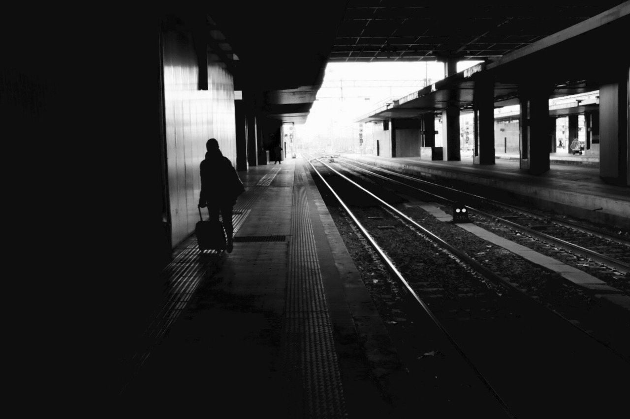 Walking Around TheMinimals (less Edit Juxt Photography) Transportation Railroad Track One Person Railroad Station Full Length Real People Rear View Men Indoors  Railroad Station Platform Public Transportation People Silhouette Urban Geometry Notes From Babylon Urban Photography Taking Photos Blackandwhite Photography Urban Exploration City Lights The City Light
