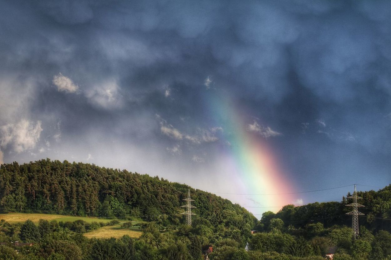 Wunder gibt es überall - und ich dufte gestern Abend eines erleben. Ein Gewitter zog herauf... und für einen flüchtigen Moment zeigte sich am Himmel ein kleiner Regenbogen, obwohl es noch keinen einzigen Tropfen geregnet hatte... // Miracles are everywhere - last evening I was allowed to experience one. A thunderstorm seems to come up ... and for a fleeting moment a small rainbow appeared in the sky, even though it had not rained a single drop ...🌫🌈💧🌞 Beauty In Nature Blue Hour Clouds And Sky Cloudscape Connected With Nature Evening Light Exceptional Photographs Eye4nature EyeEm Best Shots - Nature From My Window Go For Green 💚 Golden Hour Heartbeat Moments Life's Simple Pleasures... Live With Passion, Love With Passion ❤️ Make Love Great Again 💖 Peaceful View Place Of Heart Rainbow Rainbow Sky Rainbow🌈 The Great Outdoors - 2017 EyeEm Awards Tranquility Unexpected Beauty Untamed Heart