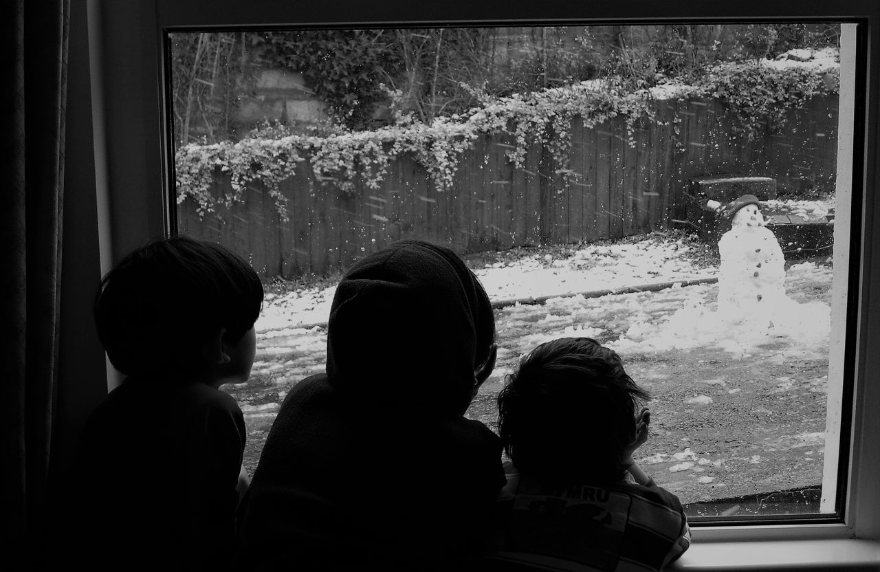 Watching our Snowman Cold Temperature Cosy Inside Friendship Kids Leisure Activity Longing Outdoors Real People Rear View Snowman Watching Out Of Window Watching Outside Watching Over Worry Childhood Childhood Memories Child's Perspective