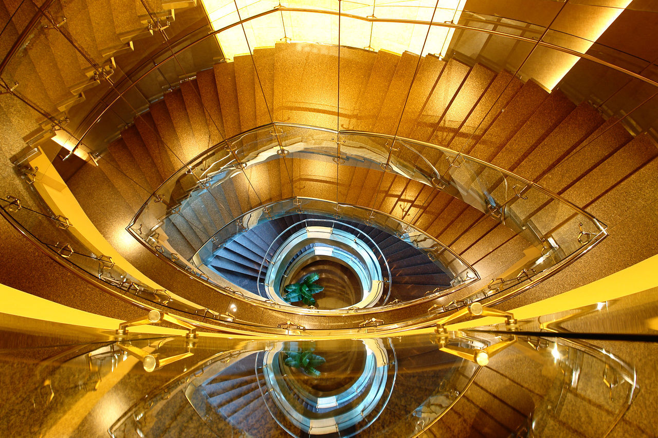 Golden staircase Architecture Built Structure Close-up Day Eye Shape Gold Colored High Angle View Indoors  Interior Design Modern Architecture No People Railing Spiral Spiral Staircase Staircase Steps Steps And Staircases