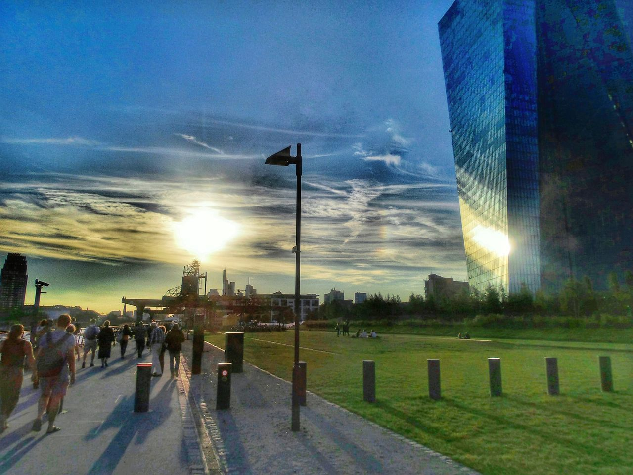 Walking Into The Light Large Group Of People Walking Along The Riverbank ☺ of the Main River in Frankfurt Am Main Germany🇩🇪 EZB Building At The Horizon Sunset Sunset Silhouettes Sky Sky And Clouds Skyline Frankfurt Skyscrapers Evening Light Evening Walk Outdoors Nature people walking to an Open Air Classical Concert EyeEm Diversity Art Is Everywhere The Photojournalist - 2017 EyeEm Awards Visual Feast The Architect - 2017 EyeEm Awards The Street Photographer - 2017 EyeEm Awards