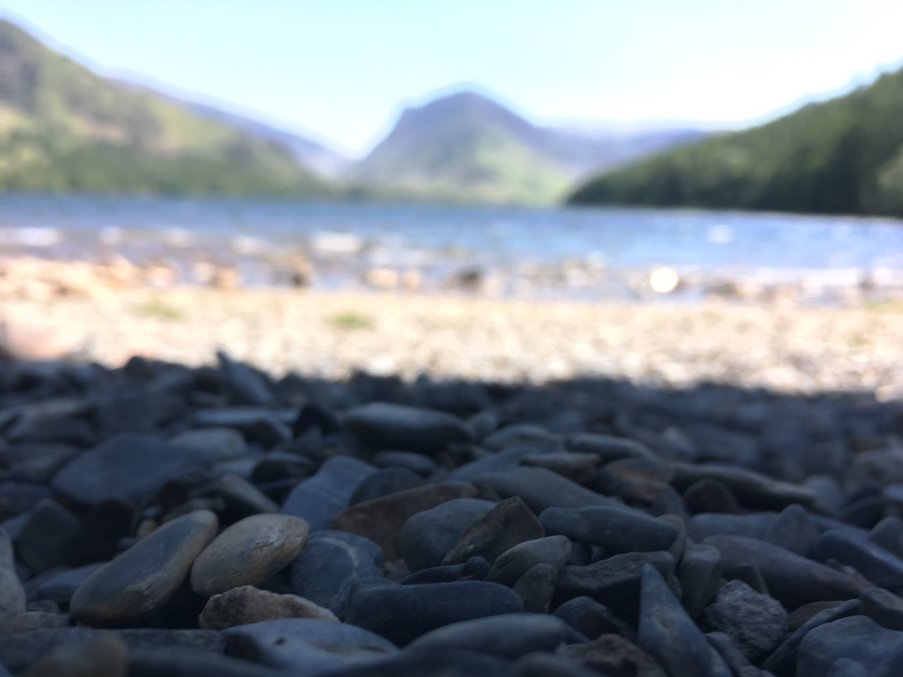 beach, shore, pebble, nature, no people, pebble beach, water, beauty in nature, outdoors, day, tranquility, mountain, sea, sand, scenics, close-up, sky