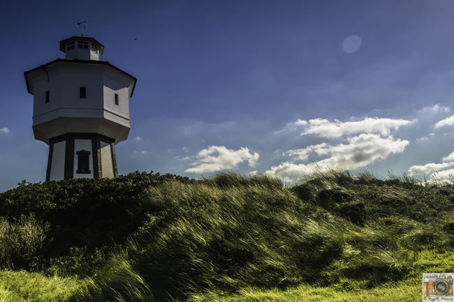 Architecture Architecture Building Exterior Built Structure Cloud Cloudfield Grassy Hilltower Langeoog Lighthouse Nature Nikon Nikon D5500 Nikon D5500 Inner Structure Model Nikonphotography Outdoors Outdoors Photograpghy  Scene Tranquility Watertank Watertower