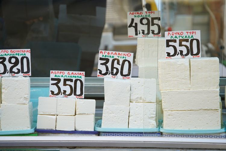 Greek Feta Cheese on the Market Greece Artisan Farmers Market Cheese Greek Cuisine Greek Food Feta Cheese Feta Text No People Stack Variation Communication Indoors  Large Group Of Objects Food