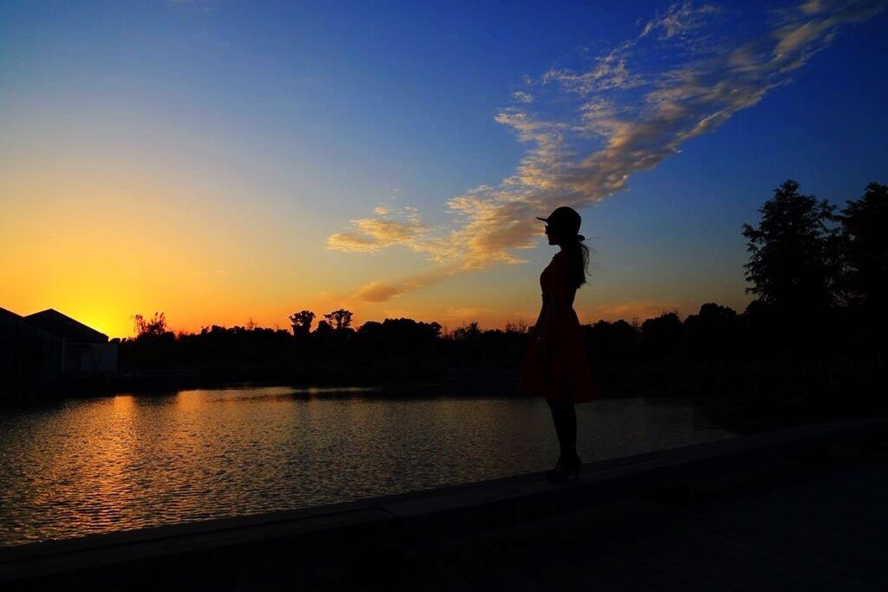 silhouette, sunset, sky, water, cloud - sky, leisure activity, full length, one person, real people, standing, nature, reflection, tree, outdoors, scenics, lifestyles, lake, beauty in nature, men, women, adult, adults only, people, day