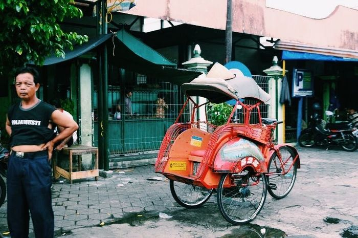 Tired People Traveling Becak