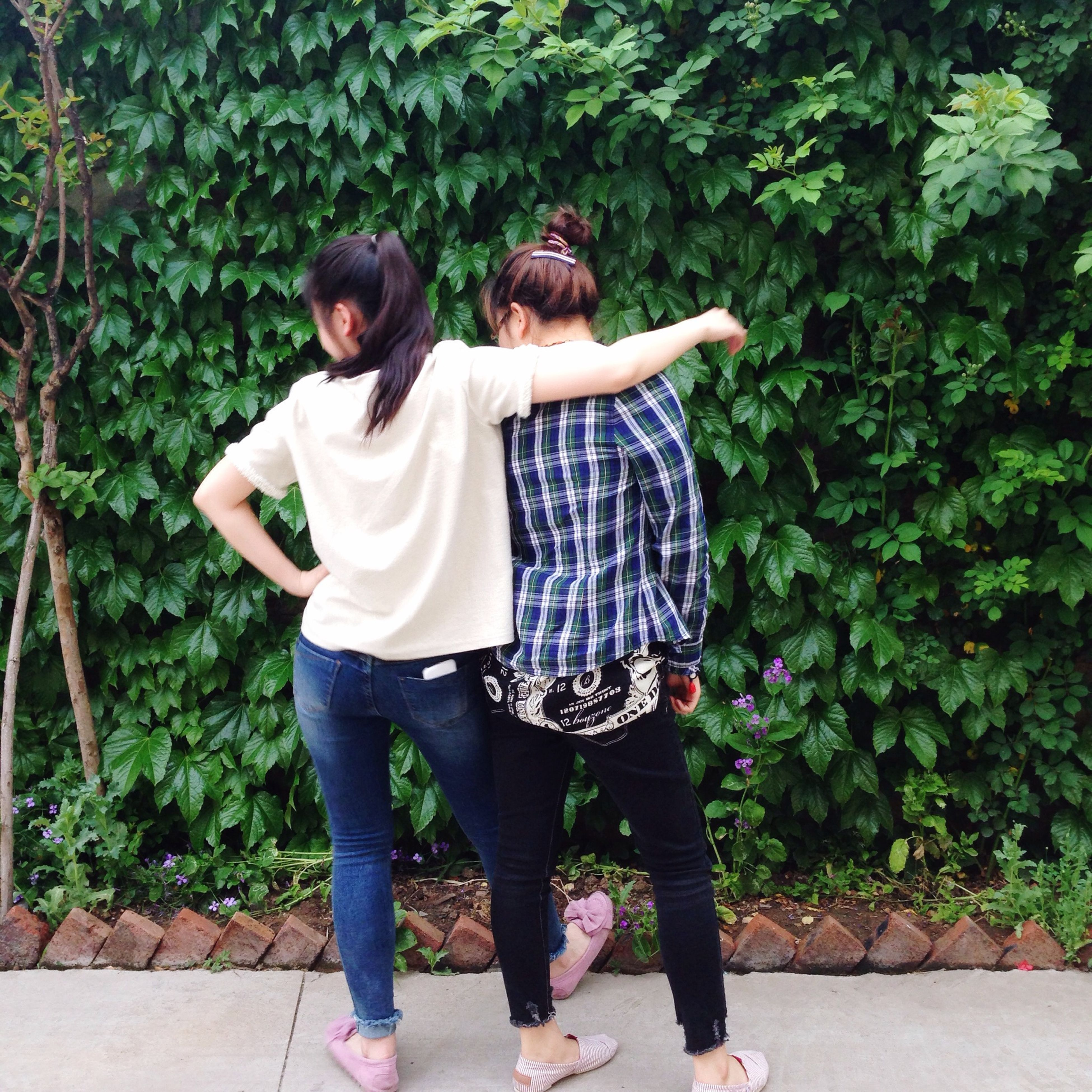full length, casual clothing, lifestyles, leisure activity, togetherness, bonding, person, tree, love, rear view, standing, childhood, girls, plant, park - man made space, young women, young adult