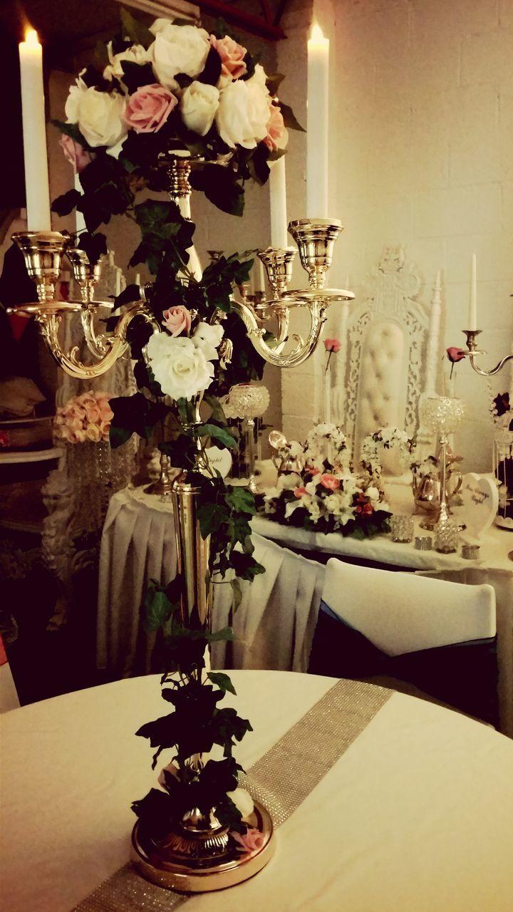 candle, table, indoors, decoration, celebration, vase, no people, illuminated, flower, christmas decoration, night, christmas, home interior, wineglass, food, sweet food, close-up, freshness