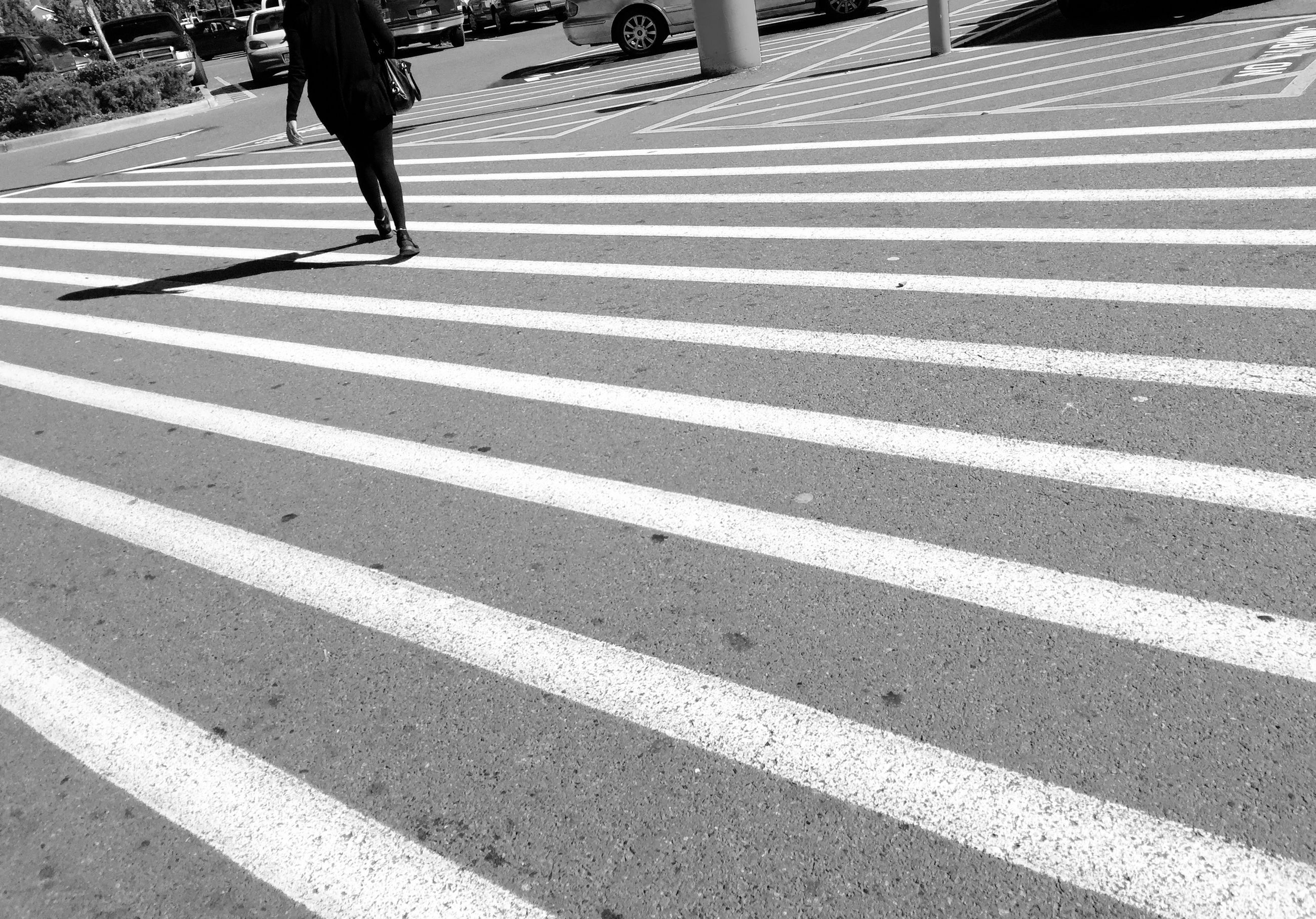road marking, street, road, asphalt, transportation, zebra crossing, striped, the way forward, shadow, low section, day, sunlight, high angle view, pattern, outdoors, walking, white color, unrecognizable person