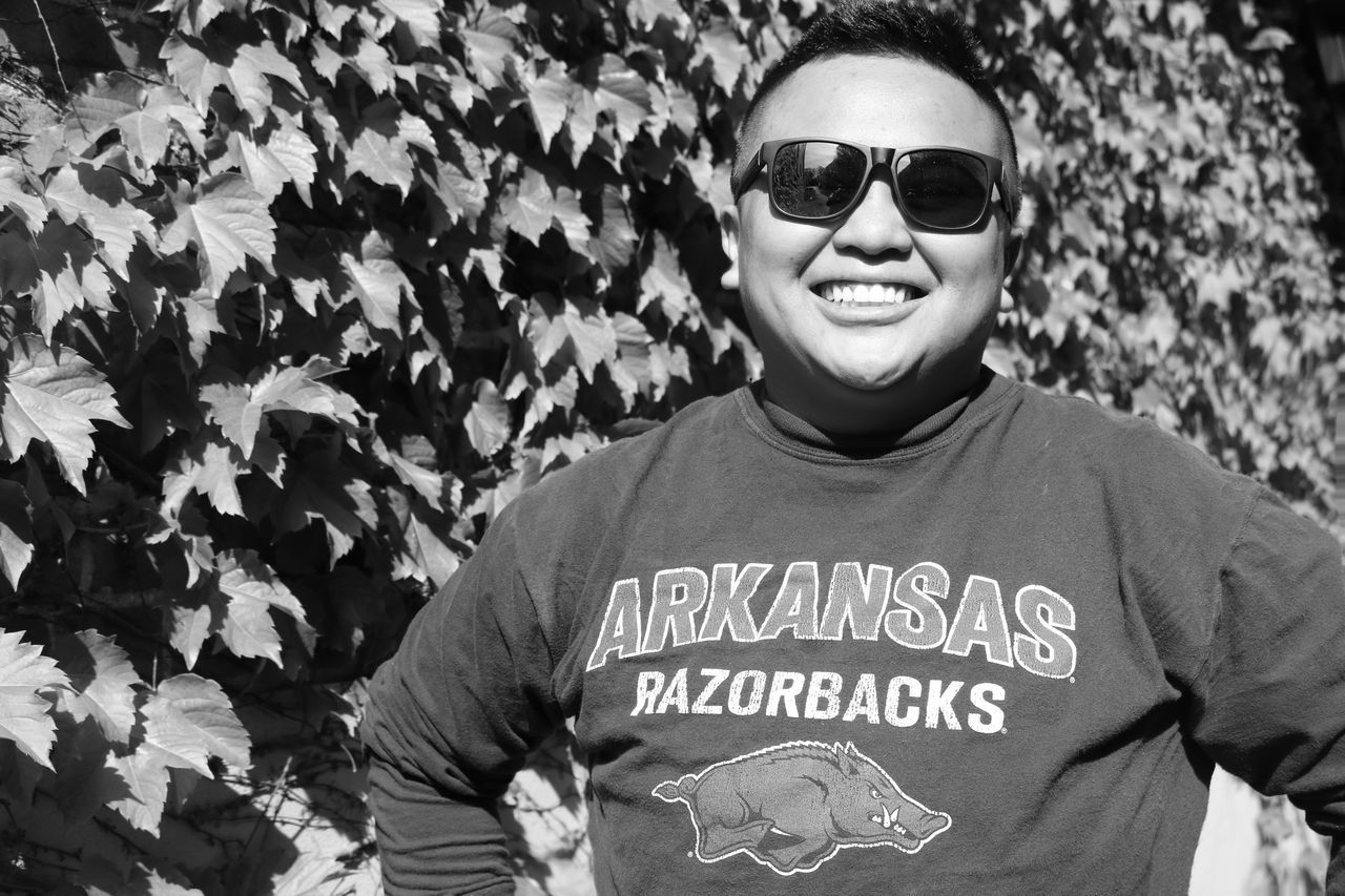 Adult Adults Only Arkansas Asian, White, Chocolate Aka Cheetah Girls Black & White Camouflage Clothing Close-up Day One Man Only One Person Outdoors People Pictureoftheday Portrait Razorbacks  Real People Siloam Springs Siloam Springs, Smile Sunglasses Vine Wall Vines