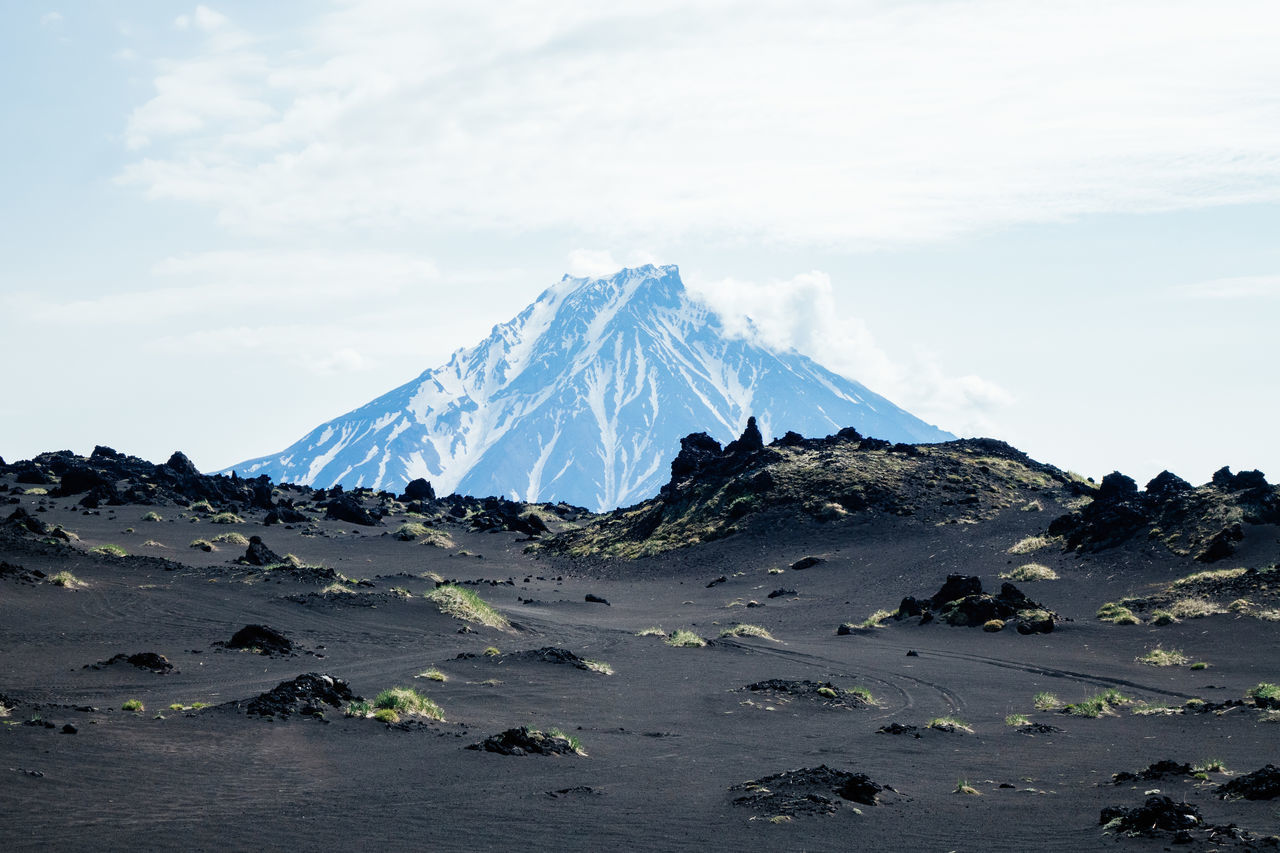 Exploring volcanoes of Kamchatka Expedition Nature Travel adventure beauty in Nature cold temperature landscape mountain Nature outdoors scenics sky snow tourism volcano wildlife