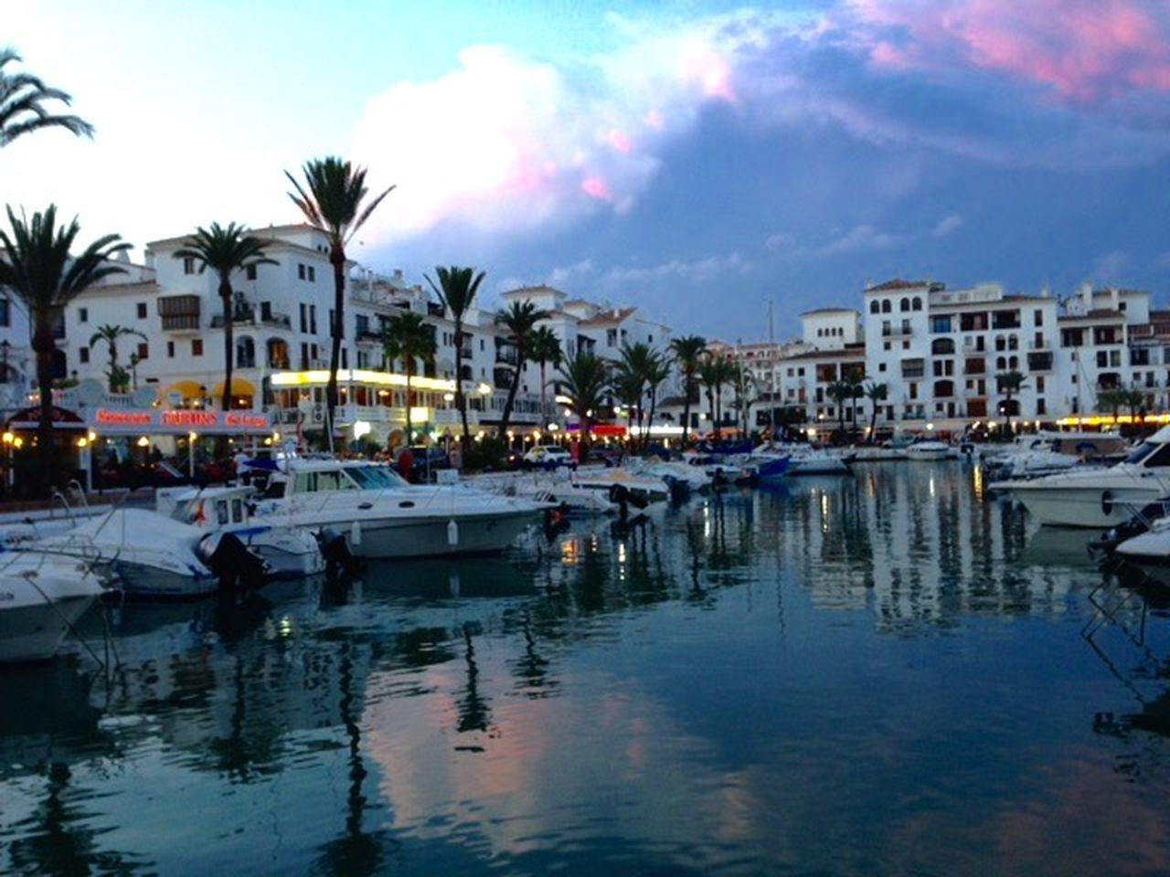 Puerto de la Duquesa marina at dusk Duquesa SPAIN Marina Dusk Water Reflections Luxury Boats Bars And Restaurants
