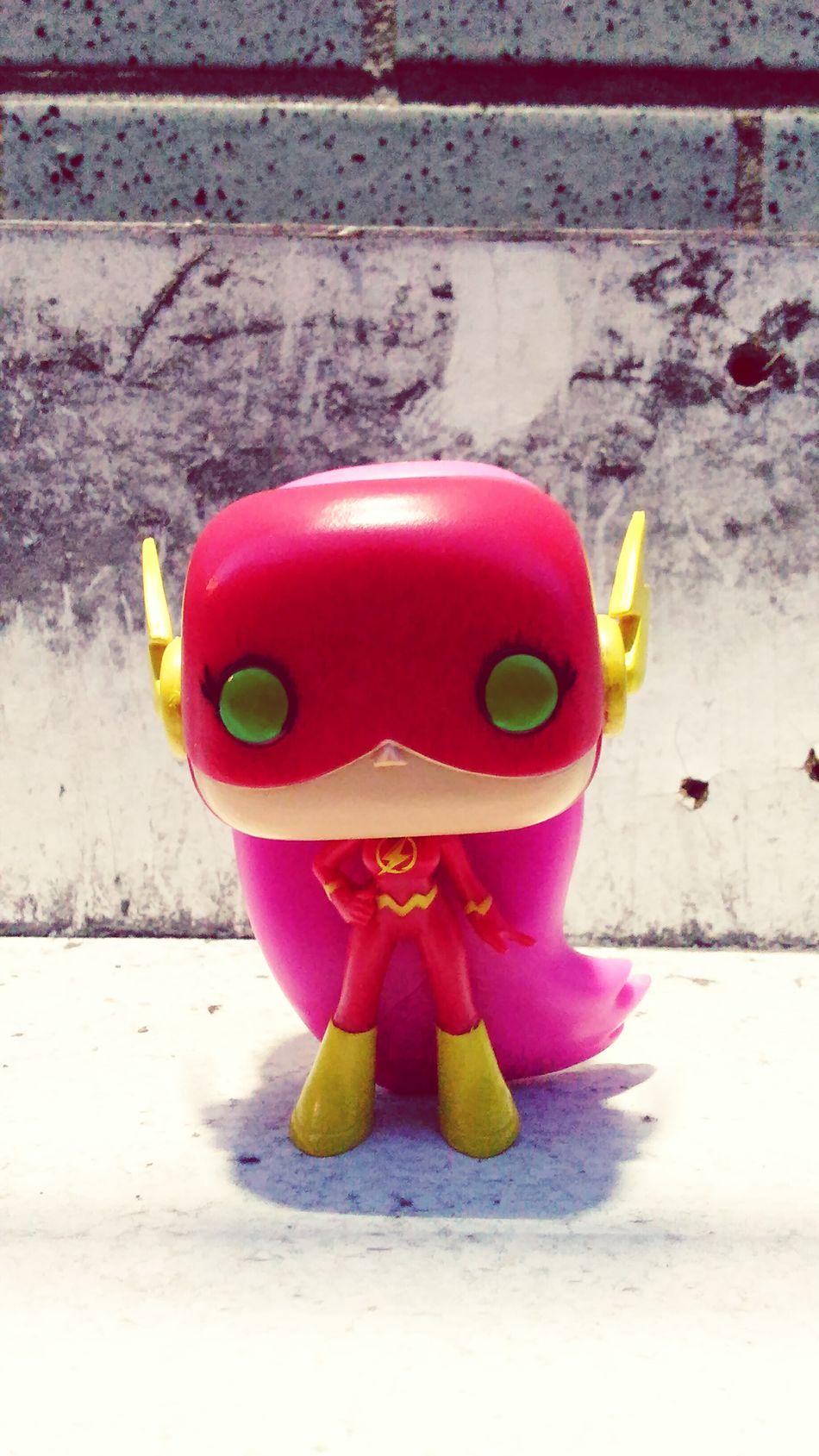 Vibrant Color Starfire Theflash Teentitans Multi Colored Funkopopvinyl Concrete Concrete Jungle Concrete Wall Front View Imagination Colorful Fun Bestever In Front Of Eyem Best Shots Upclose  Smiley Face Amazing Creativity Outdoors Lettherebelight Flash Close-up Still Life