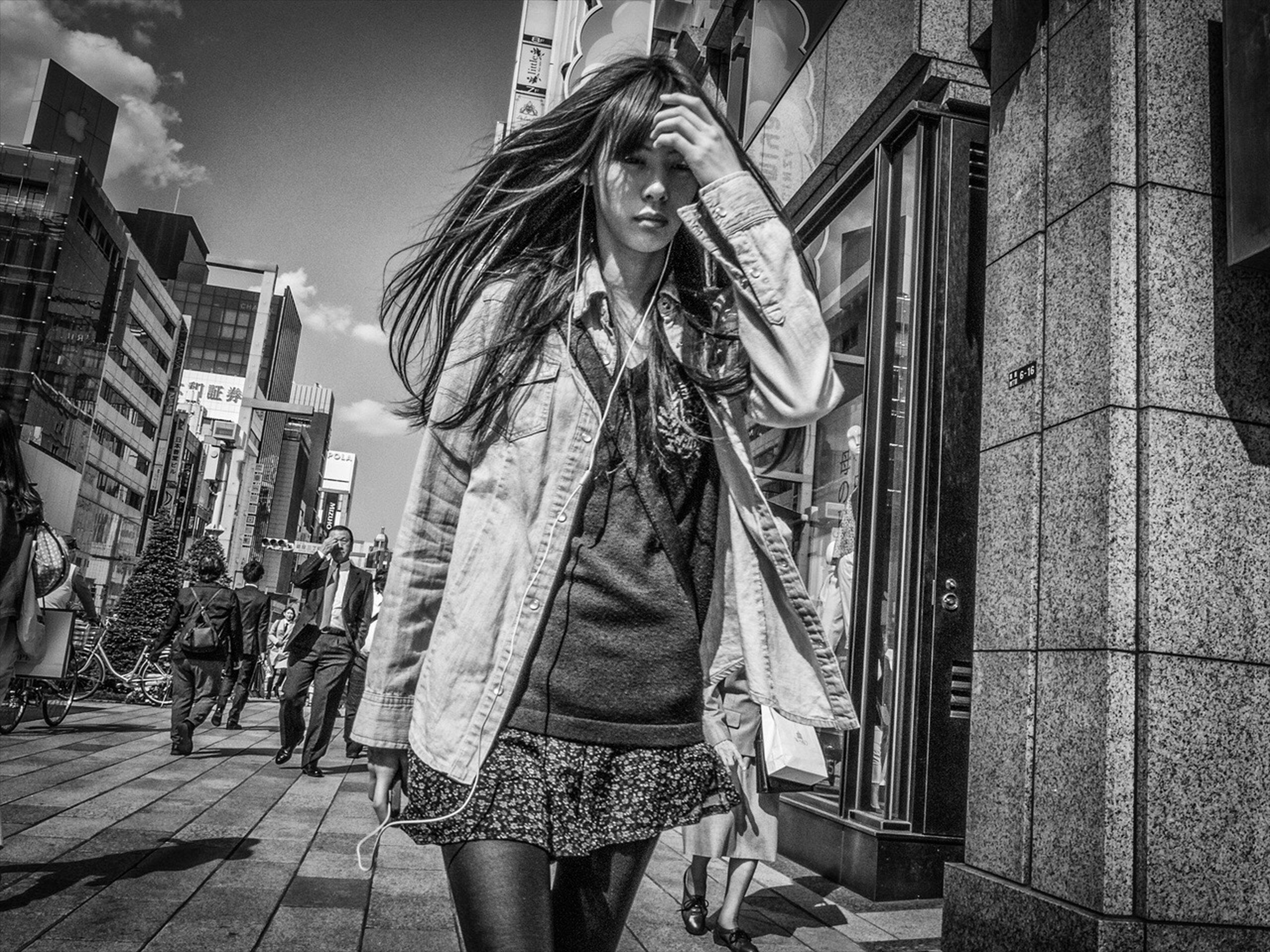 building exterior, architecture, built structure, lifestyles, casual clothing, standing, leisure activity, young adult, full length, city, young women, street, front view, building, person, walking, three quarter length