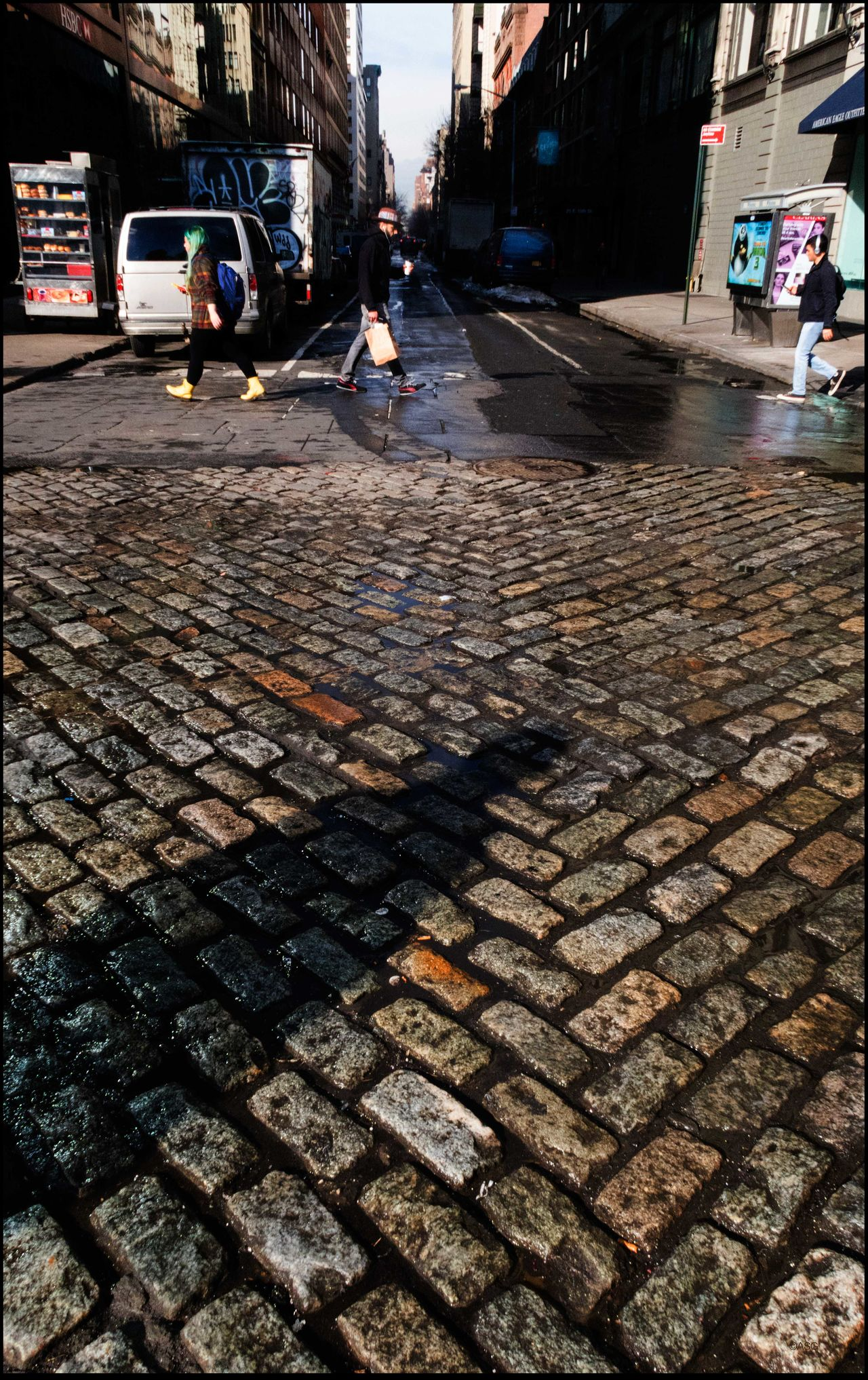 Walking on Cobblestones - 2/1/16 Cobblestone Man's Shadow Pattern People Walking  Street Photography NYC Street Vender Wet Streets