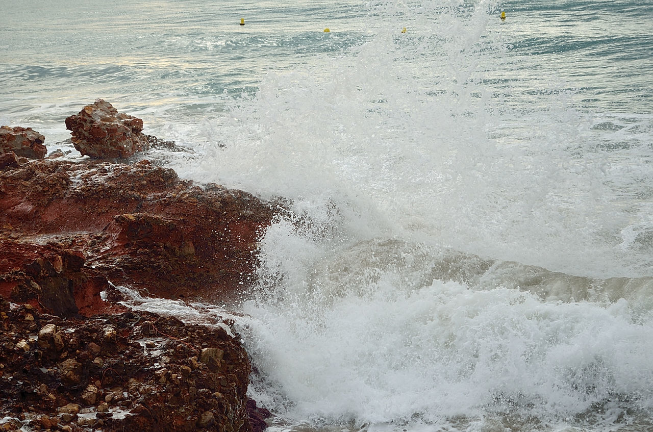 motion, rough, water, power in nature, sea, crash, wave, nature, rock - object, breaking, no people, force, beauty in nature, day, high angle view, outdoors, hitting
