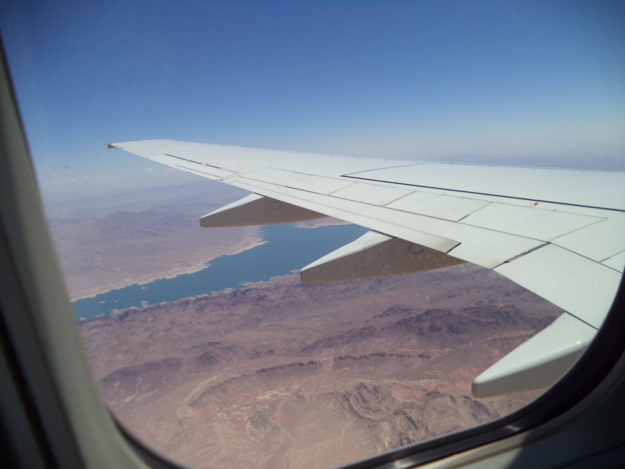 airplane, aerial view, transportation, journey, mode of transport, airplane wing, air vehicle, travel, landscape, nature, window, day, beauty in nature, scenics, aircraft wing, no people, tranquil scene, sky, flying, outdoors, mountain, mid-air, vehicle part