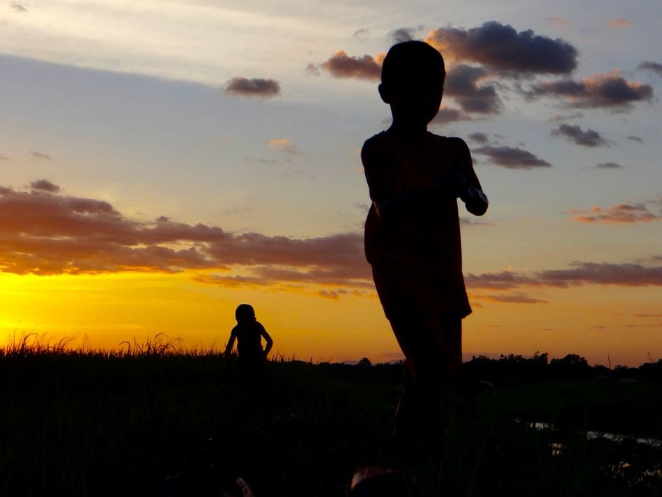 returning home Beauty In Nature Bonding Child Childhood Cloud - Sky Field Grass Leisure Activity Nature Outdoors Phillipines Real People Silhouette Silhouette Sky Sunset Togetherness Two People