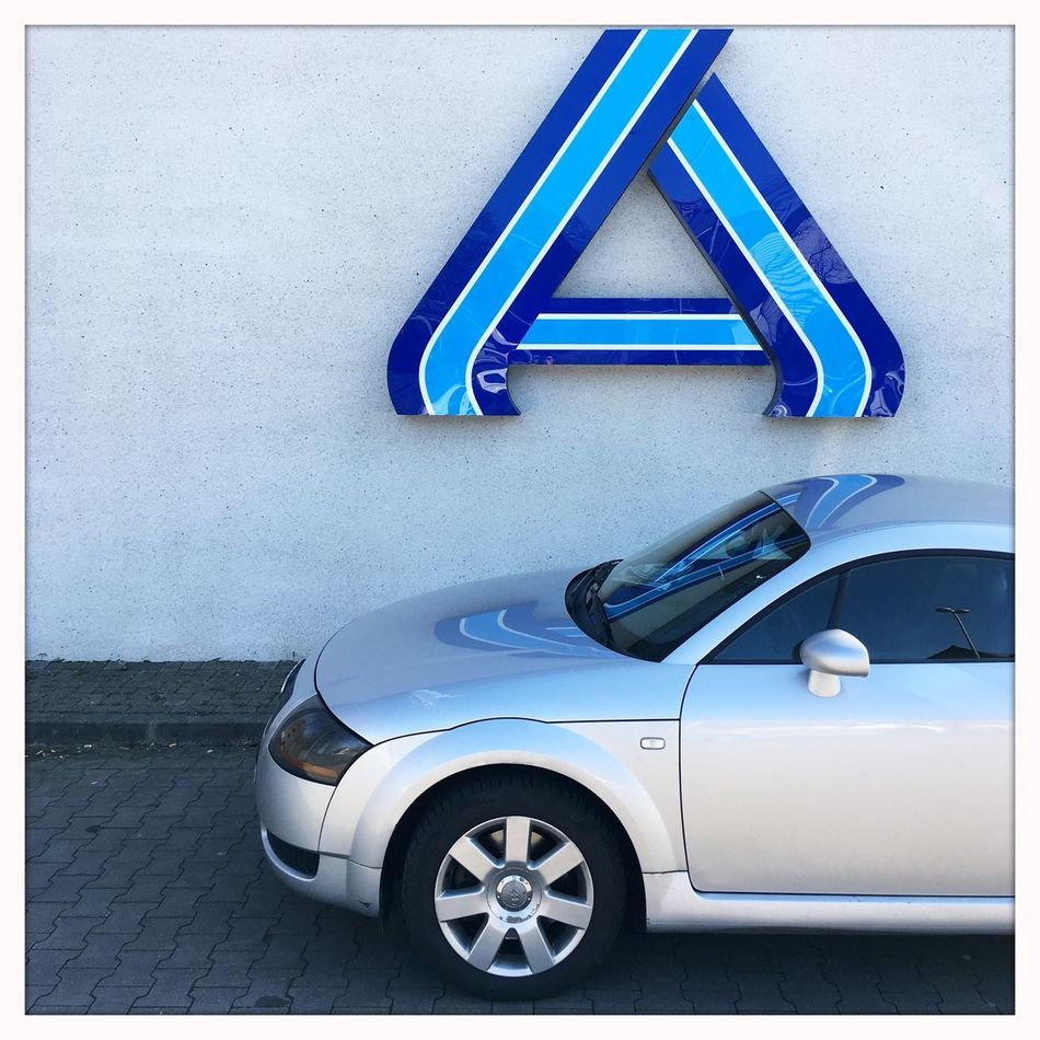 Things That Are Silver Or Blue Outdoors Close-up Car Reflection Logo Textures And Surfaces Simplicity The Drive Geilekarre Façade Architectural Feature Silver  White Plaster Parking Posing Discounter