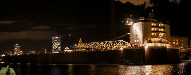 The 1000 foot Great Lakes Frieghter Burns Harbor in Milwaukee Wisconsin last winter for repairs the massive ship gleams brilliantly in the cold winter night Illuminated Night Water Waterfront City Urban Skyline Shipping  Ships⚓️⛵️🚢 Ship Harbor