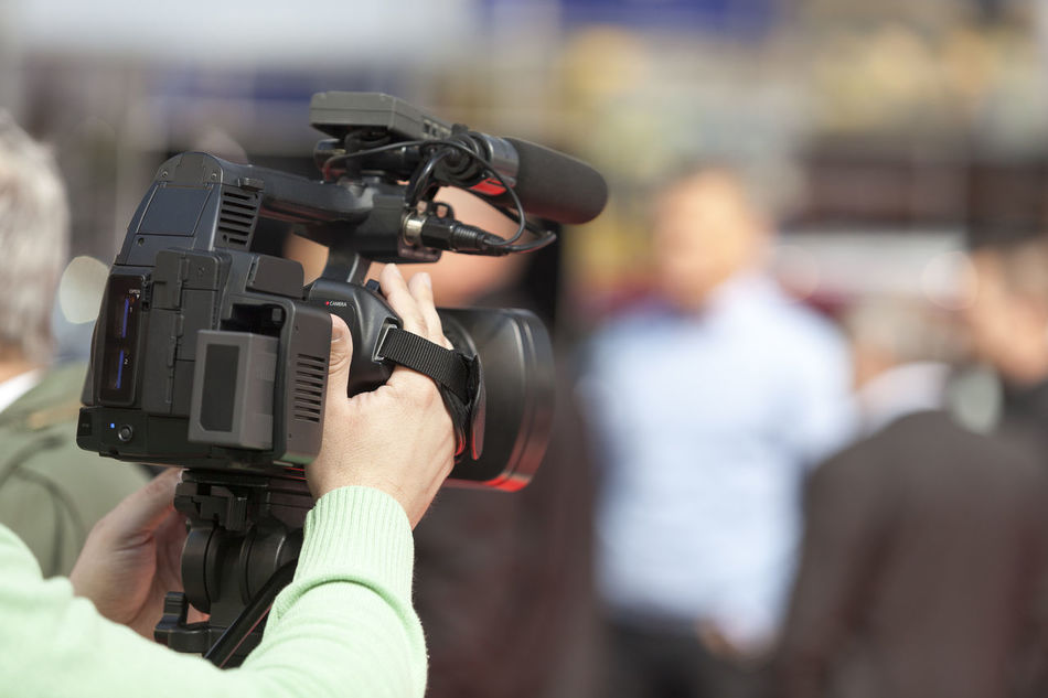 Filming an event with a video camera. Press conference. Adult Camera Operator Camerman Close-up Conference Covering Day Evening Filming Human Body Part Human Hand Journalist Lens - Eye Media Men Occupation Outdoors People Press Professional Occupation Television Camera Video Camera Working