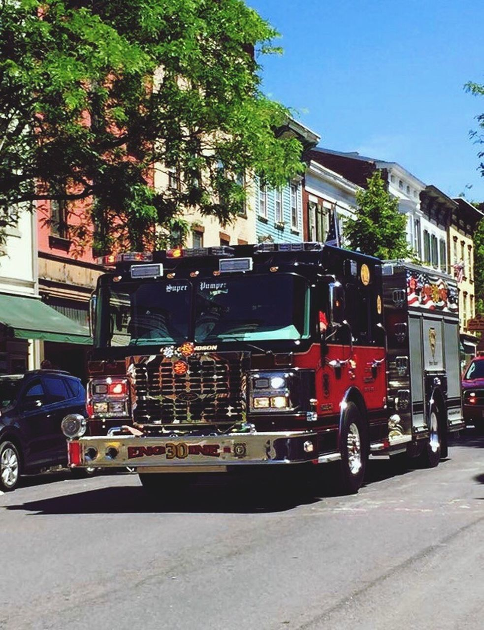 building exterior, built structure, architecture, land vehicle, outdoors, day, real people, fire engine, road, men, tree, firefighter, sky, city, people
