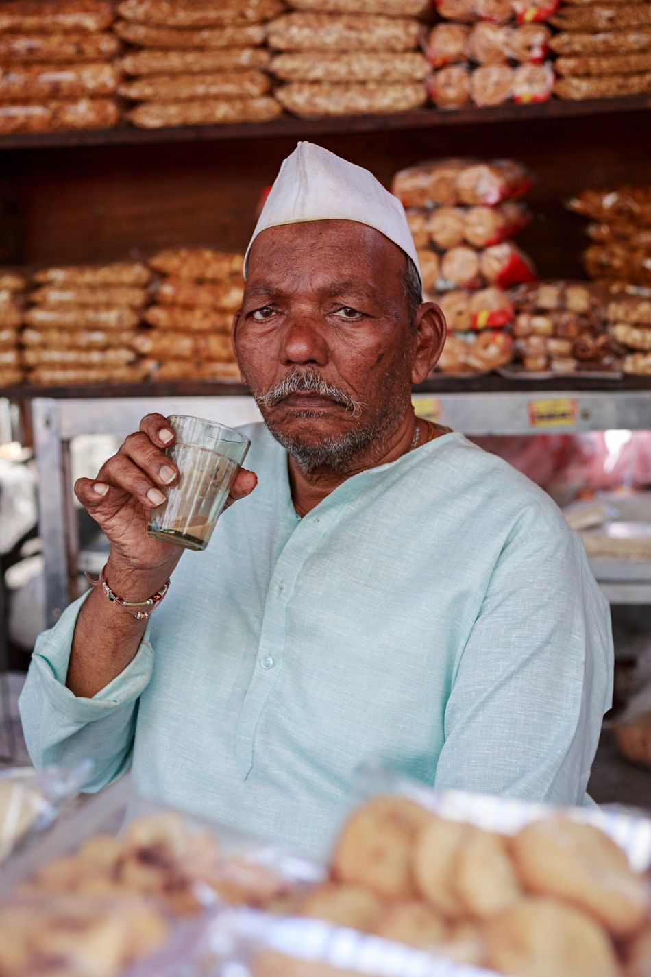 Cutting Chai / Half A Glass Tea, is what we call it in Hindi. A General Store Vendor Drinking his cup of tea. Pune, India. Food Senior Adult Adults Only Only Men Men Portrait Eating Looking At Camera Males  Adult One Man Only Archival Groceries People Gourmet Currency Buying