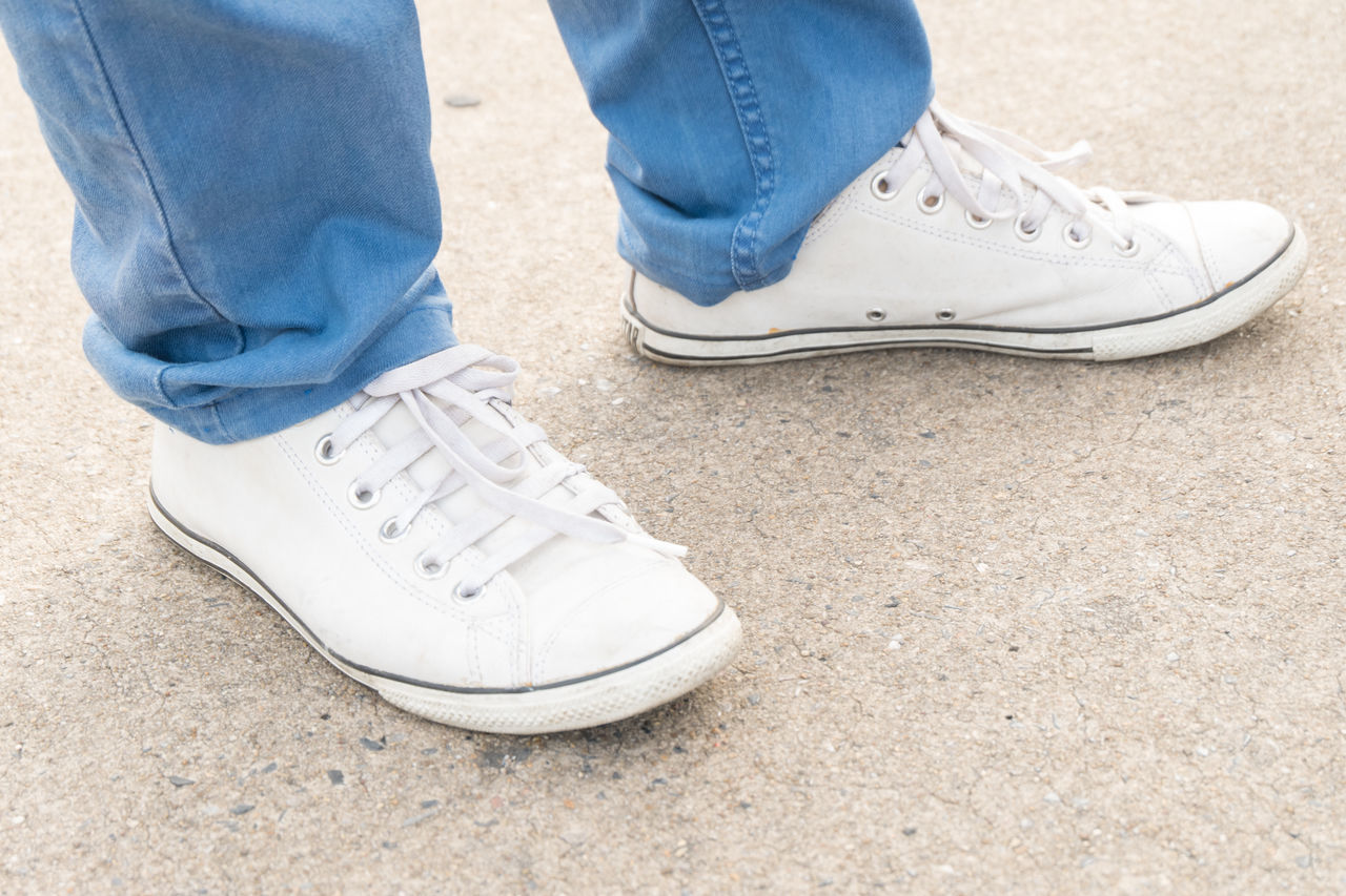 white shoes on street Blue Close-up Concrete Concrete Floor Day Fashion Floor Ground Jeans Lifestyles Outdoors Road Shoe Shoes Street Way White