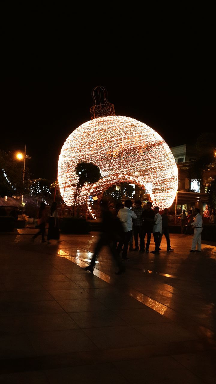 night, illuminated, real people, leisure activity, men, large group of people, lifestyles, women, outdoors, full length, christmas decoration, city, sky, people