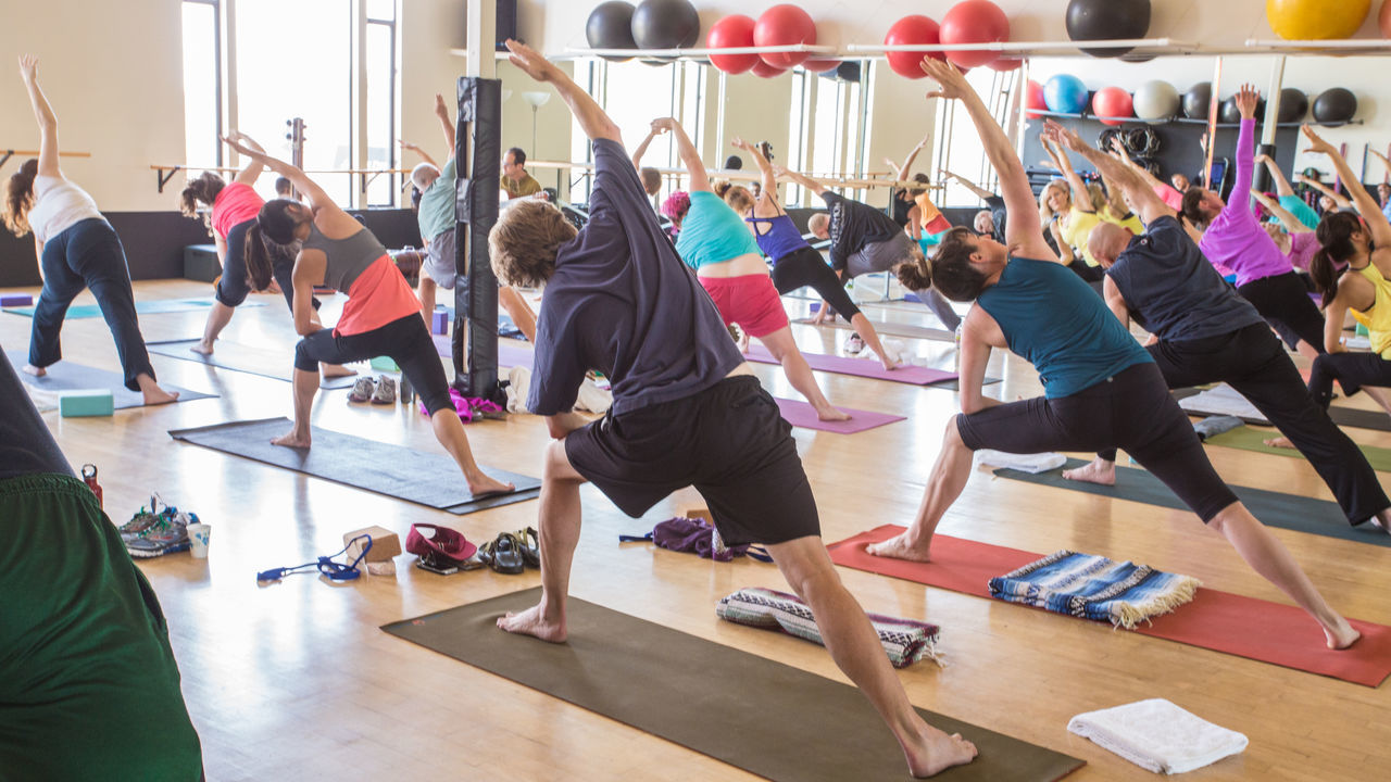 Outdoors Yoga Practice Balance Day Exercise Class Exercise Equipment Exercising Flexibility Full Length Gym Health Club Healthy Lifestyle Indoors  Learning Lifestyles Men Real People Self Improvement Sports Clothing Strength Student Studio Togetherness Women Yoga Yoga Young Adult