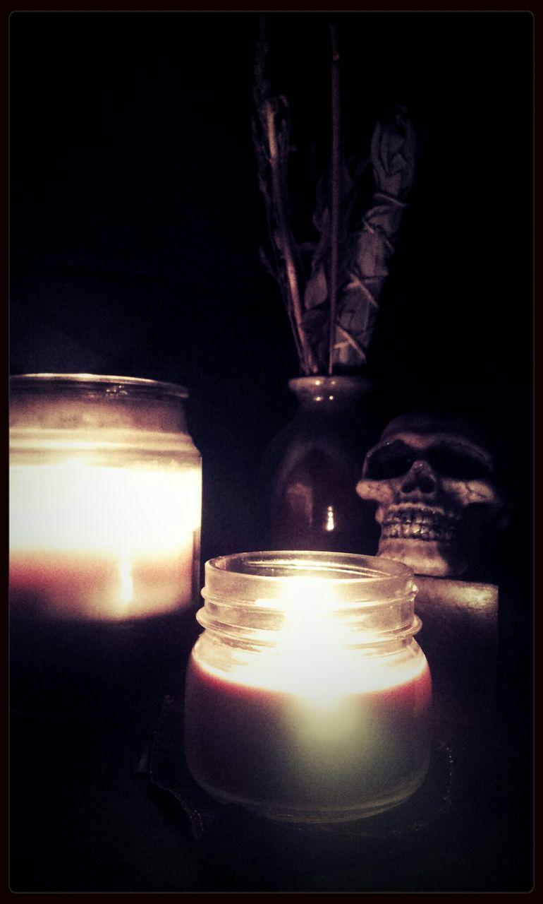 candle, flame, illuminated, burning, glowing, night, indoors, lighting equipment, tea light, spirituality, religion, close-up, no people, heat - temperature, table, black background, animal themes