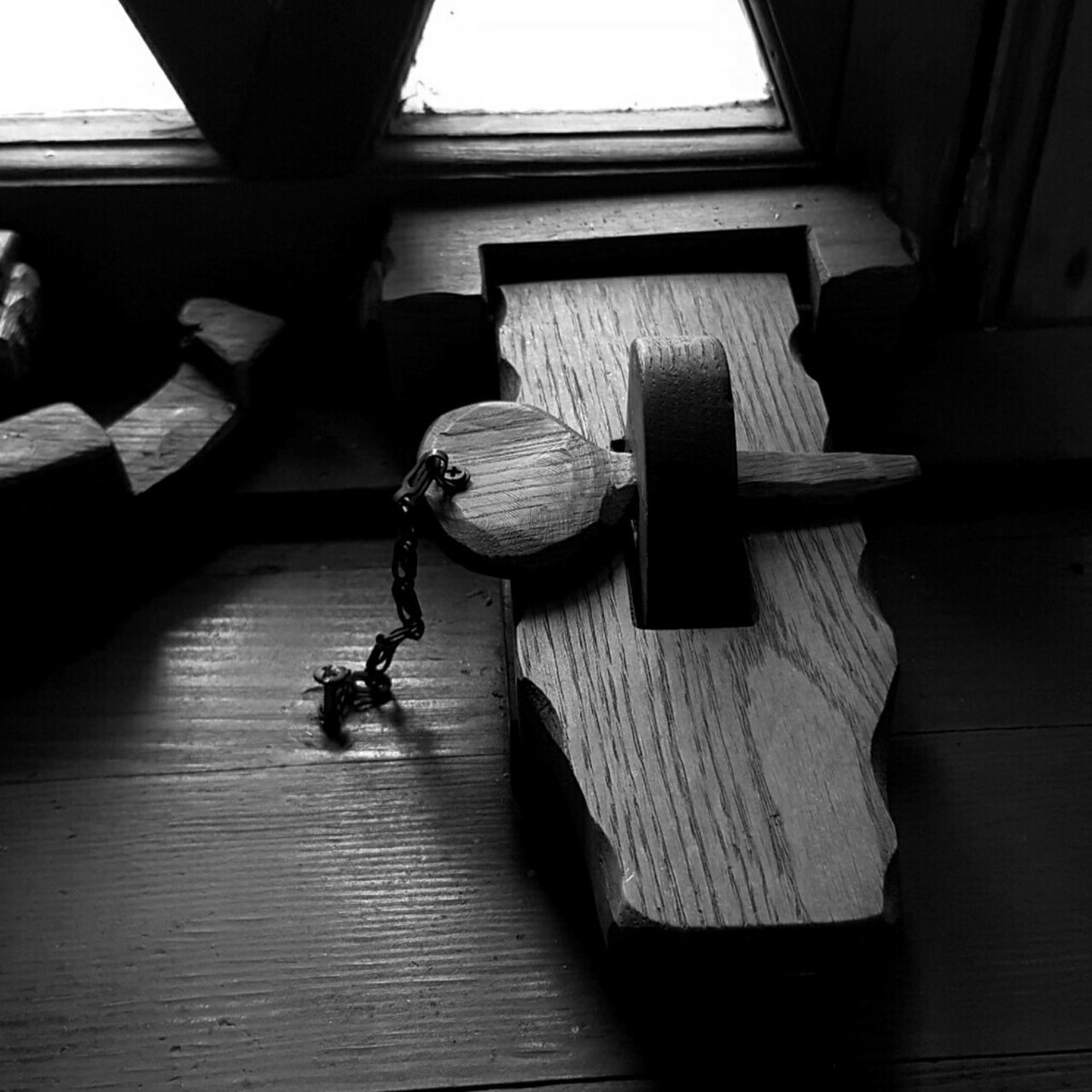 High Angle View Of Wooden Latch On Table