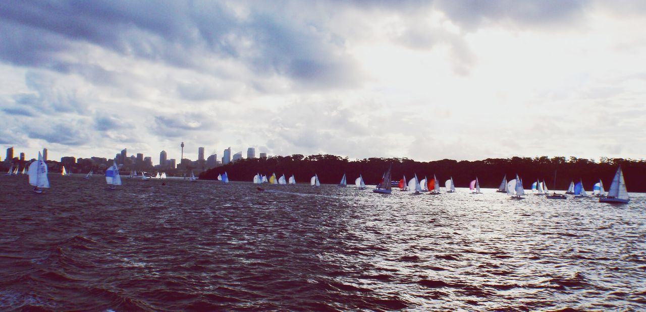 View Of Sailboats Racing In River