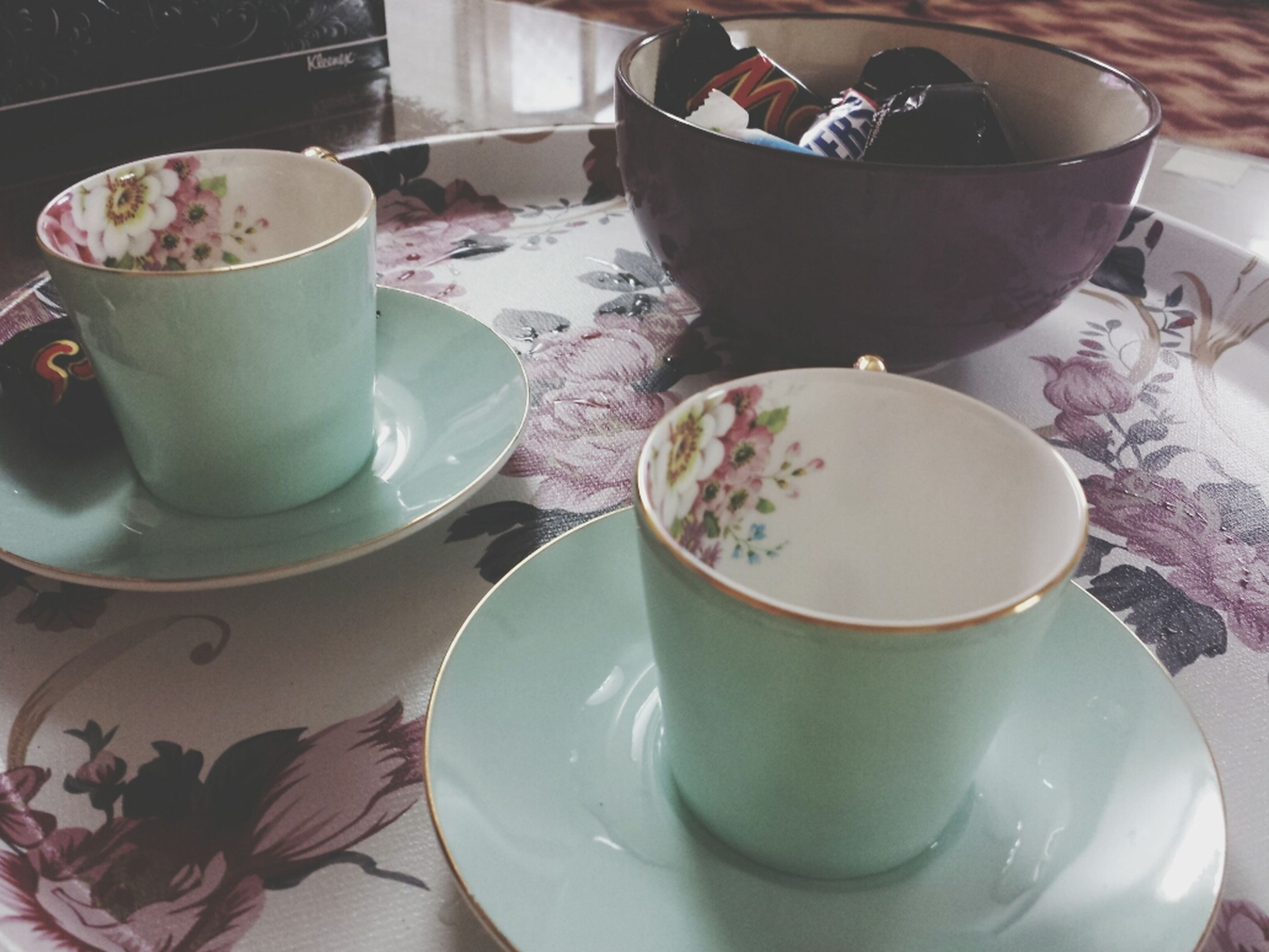 food and drink, drink, coffee cup, indoors, refreshment, coffee - drink, table, saucer, freshness, cup, coffee, spoon, still life, breakfast, plate, high angle view, food, tea cup, frothy drink, bowl