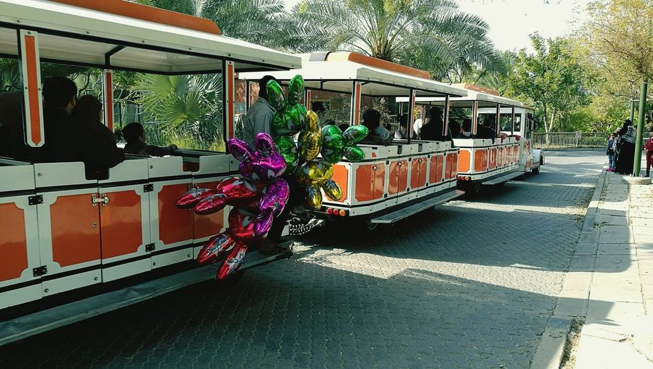 EyeEmNewHere family train Sunlight Outdoors Real People Land Vehicle Train Inside The Zoo Mode Of Transport Daytime Photography Winter Morning Urban Photography Photography Themes Full Length Multi Colored Togetherness Decorativeplates Rearviewmirrorshot Cold Temperature