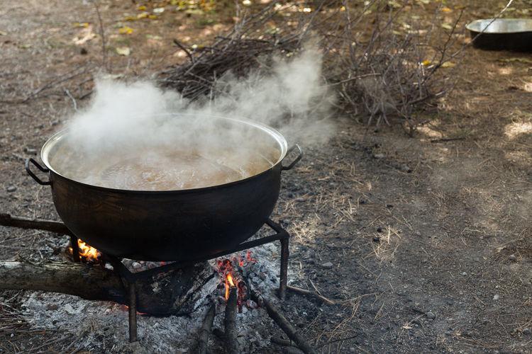 making apple molasses Apples Boiling Cooking Flames Kazan Kettle Making Molasses Outdoors Pears Pekmez Pekmez Yapimi Pot Steam Turkey Wood