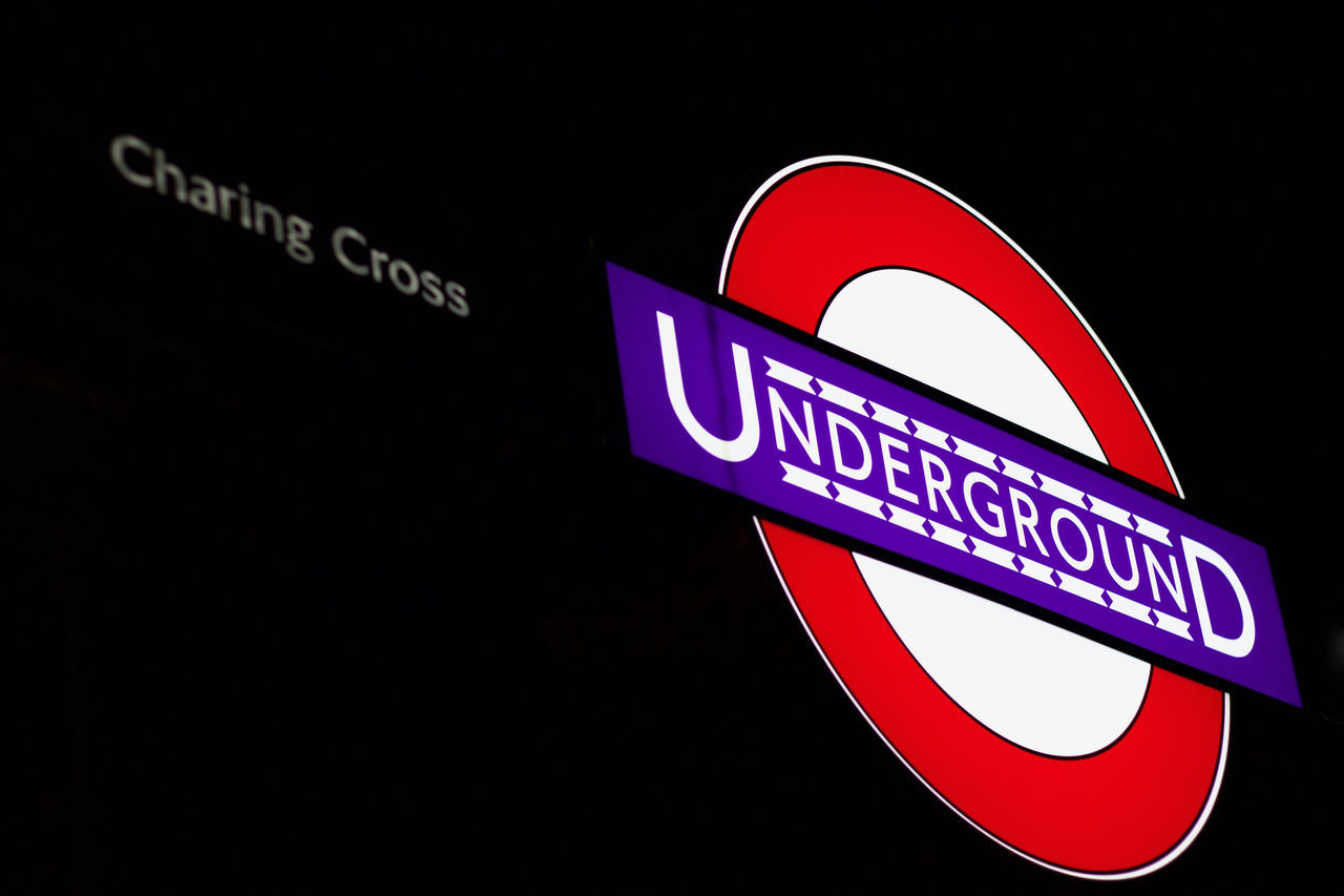 Charing Cross Station Background Backgrounds Black Background Charing Cross Close-up Communication Guidance Illuminated London Metro Night Outdoors Road Sign Station Underground EyeEm Selects Neon Life
