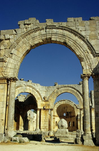 Simeon Stylites church before civil war. Ancient Ancient Civilization Arch Arched Architecture Blue Sky Building Exterior Built Structure Church Clear Sky Day History Monestary No People Old Ruin Outdoors Pilar Saint Simeon Stylites Sky Symeon The Stylite The Past Travel Destinations