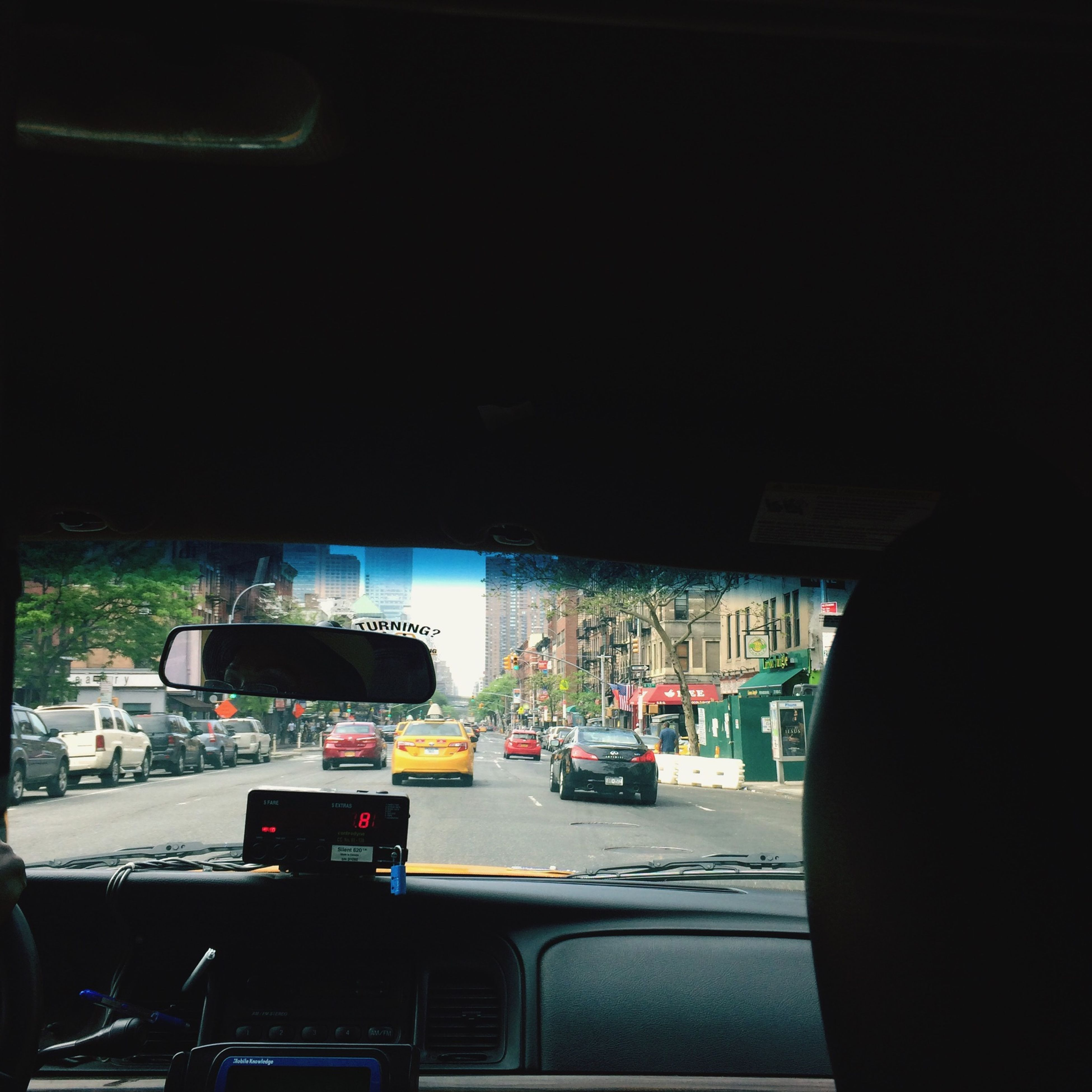 transportation, mode of transport, car, land vehicle, vehicle interior, street, travel, bus, traffic, road, city, vehicle, on the move, clear sky, window, stationary, city life, car interior, incidental people, journey