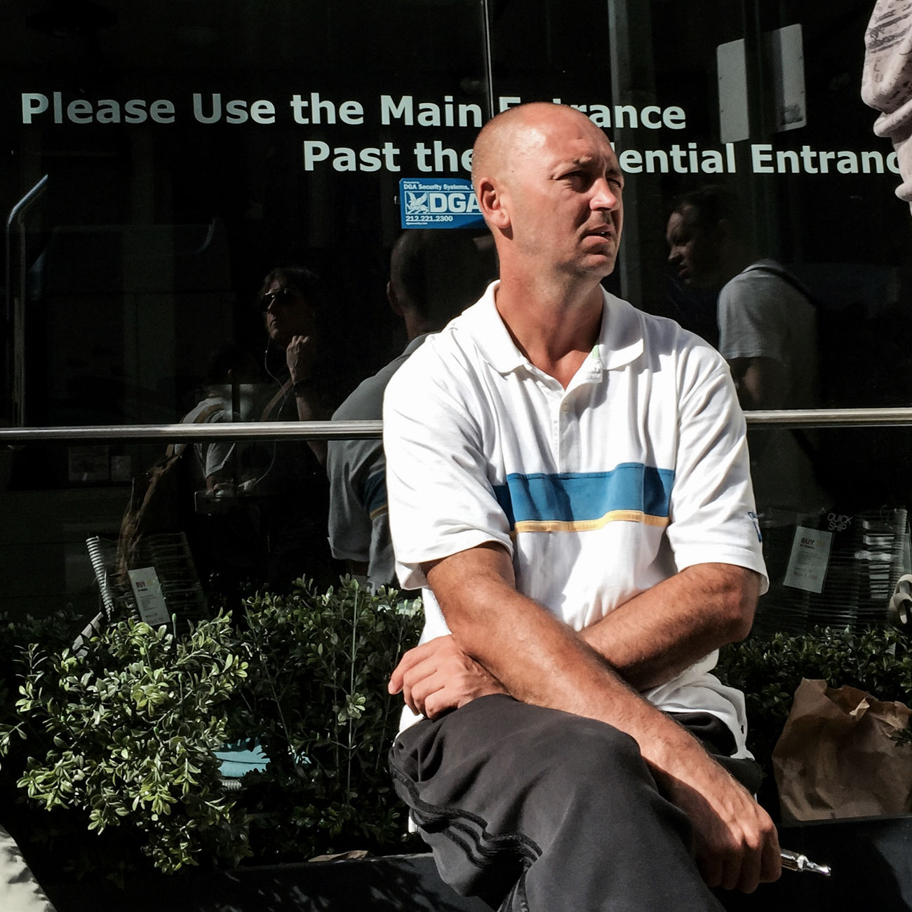 #Friday #man #working #summer2015 #chelsea #Manhattan #NYC #streetphotography #people #sunlight #breakfast #shadows @erinlhubbsphoto