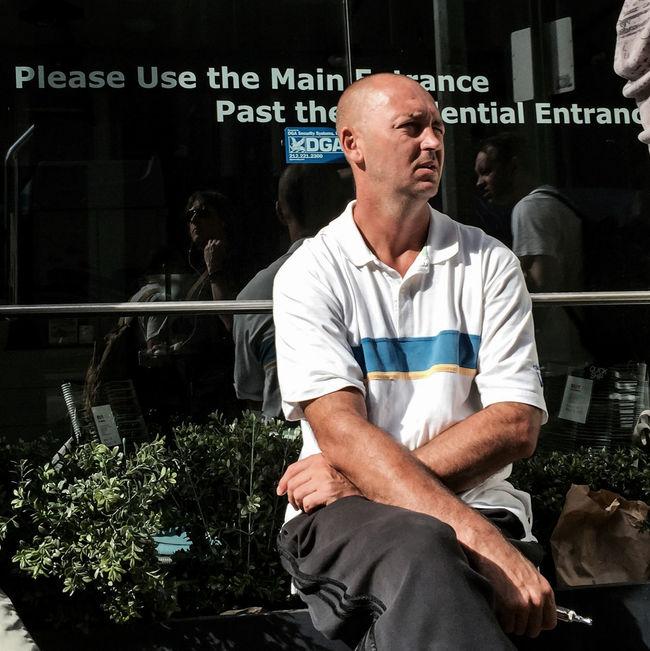#Friday #man #working #summer2015 #chelsea #Manhattan #NYC #streetphotography #people #sunlight #breakfast #shadows @erinlhubbsphoto