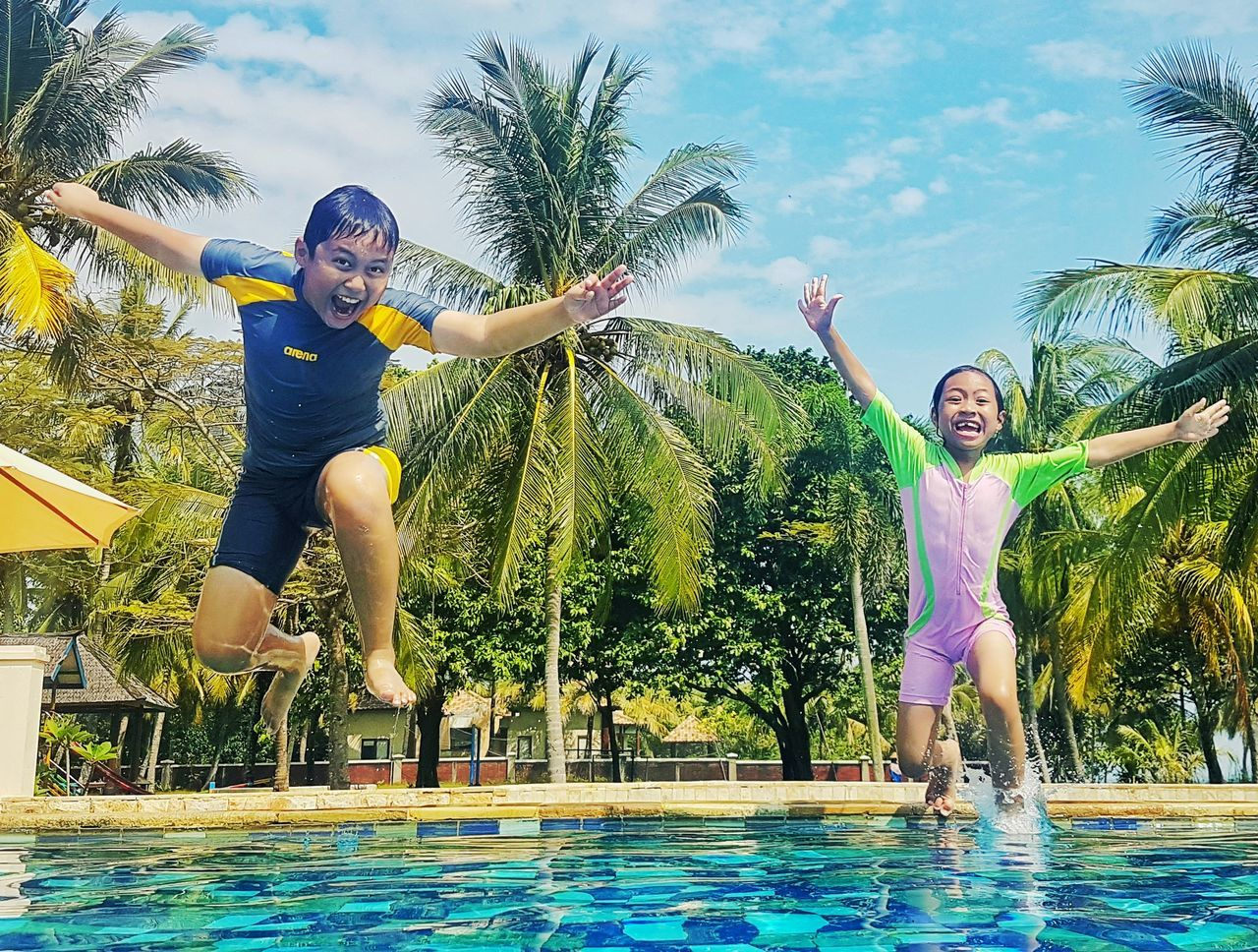 Splash! Boys Child Fun Children Only Childhood People Leisure Activity Jumping Water Swimming Pool Full Length Happiness Motion Elementary Age Playing Males  Outdoors Smiling Day Two People Kids Kids At Play